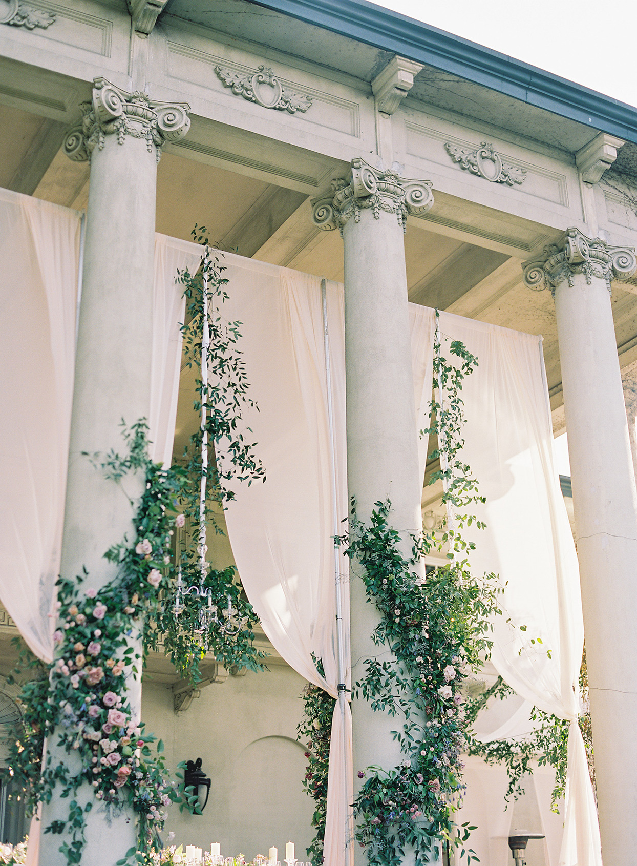 jackie ben wedding ceremony columns and hanging florals
