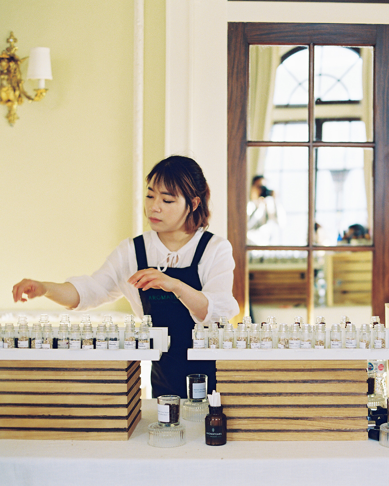 jackie ben wedding woman standing at perfume bar