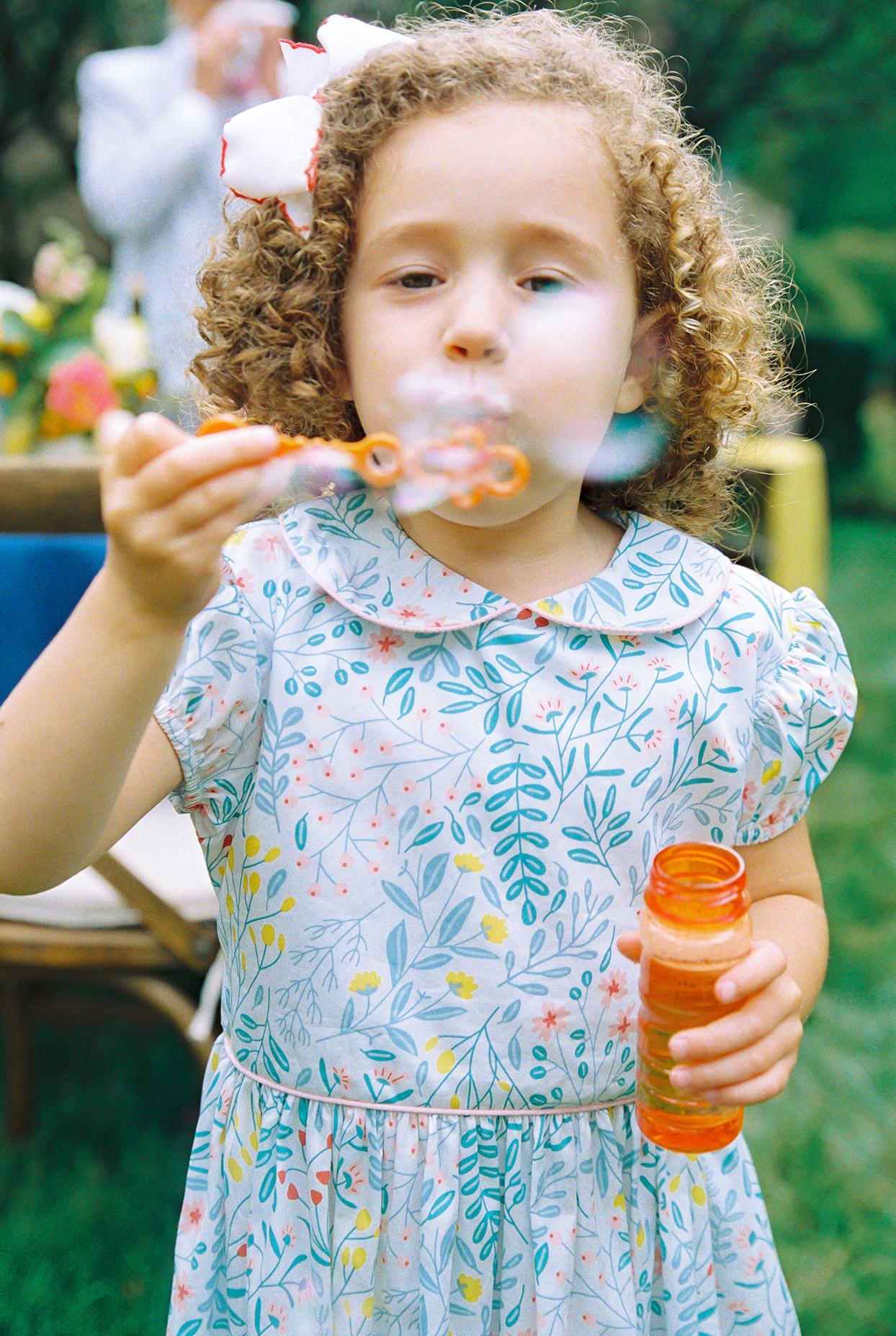 ashley scott wedding flower girl blowing bubbles