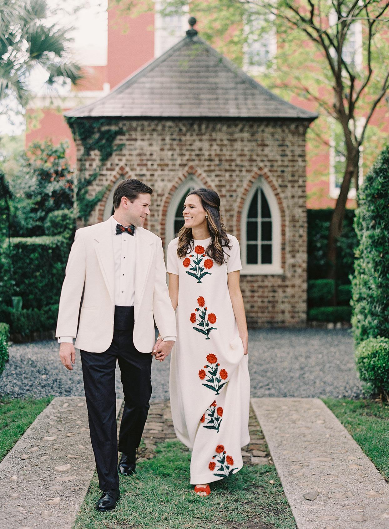 beverly steve wedding couple walking through garden