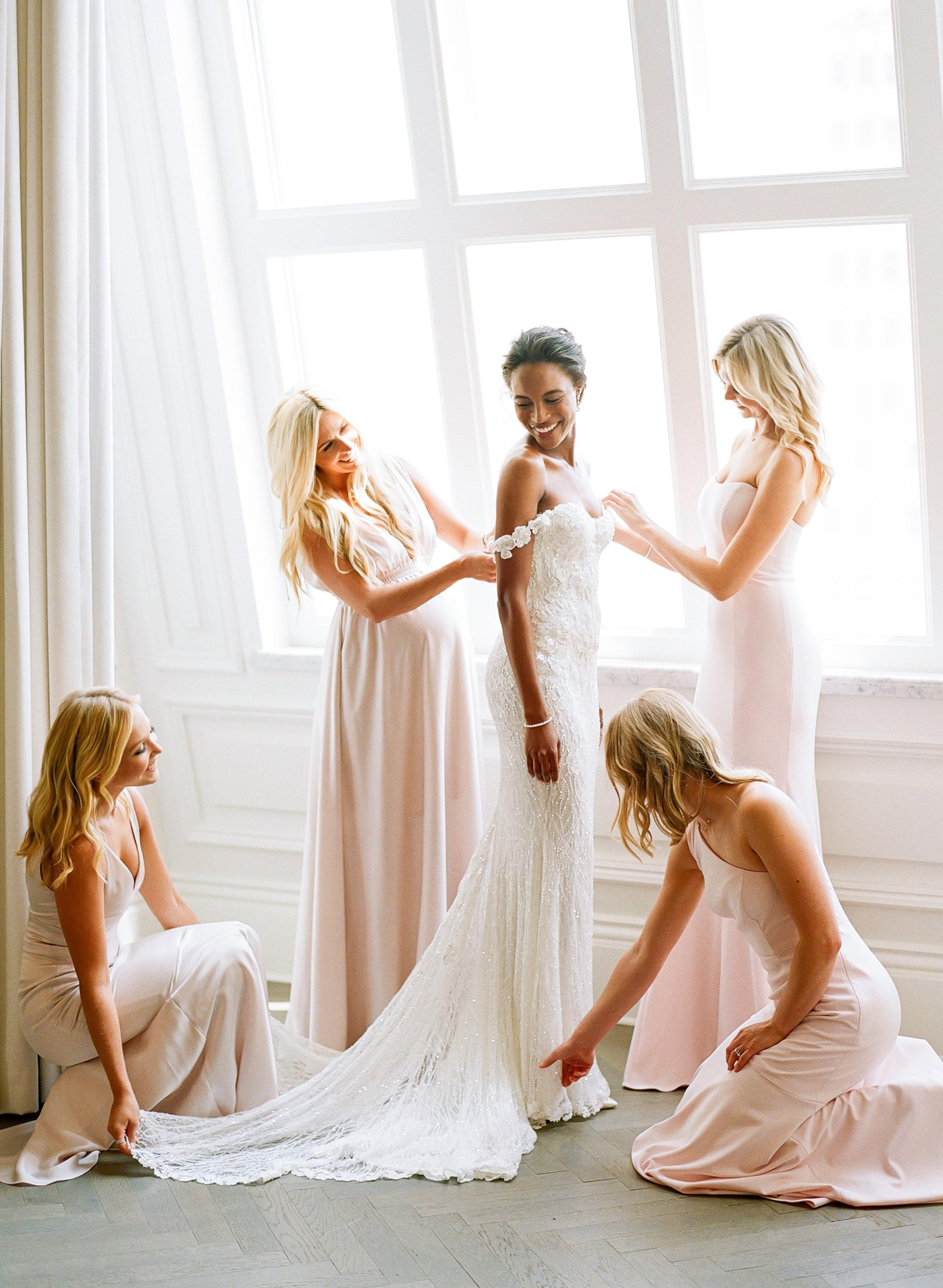 olivia colling wedding bride with bridesmaids ini blush dresses