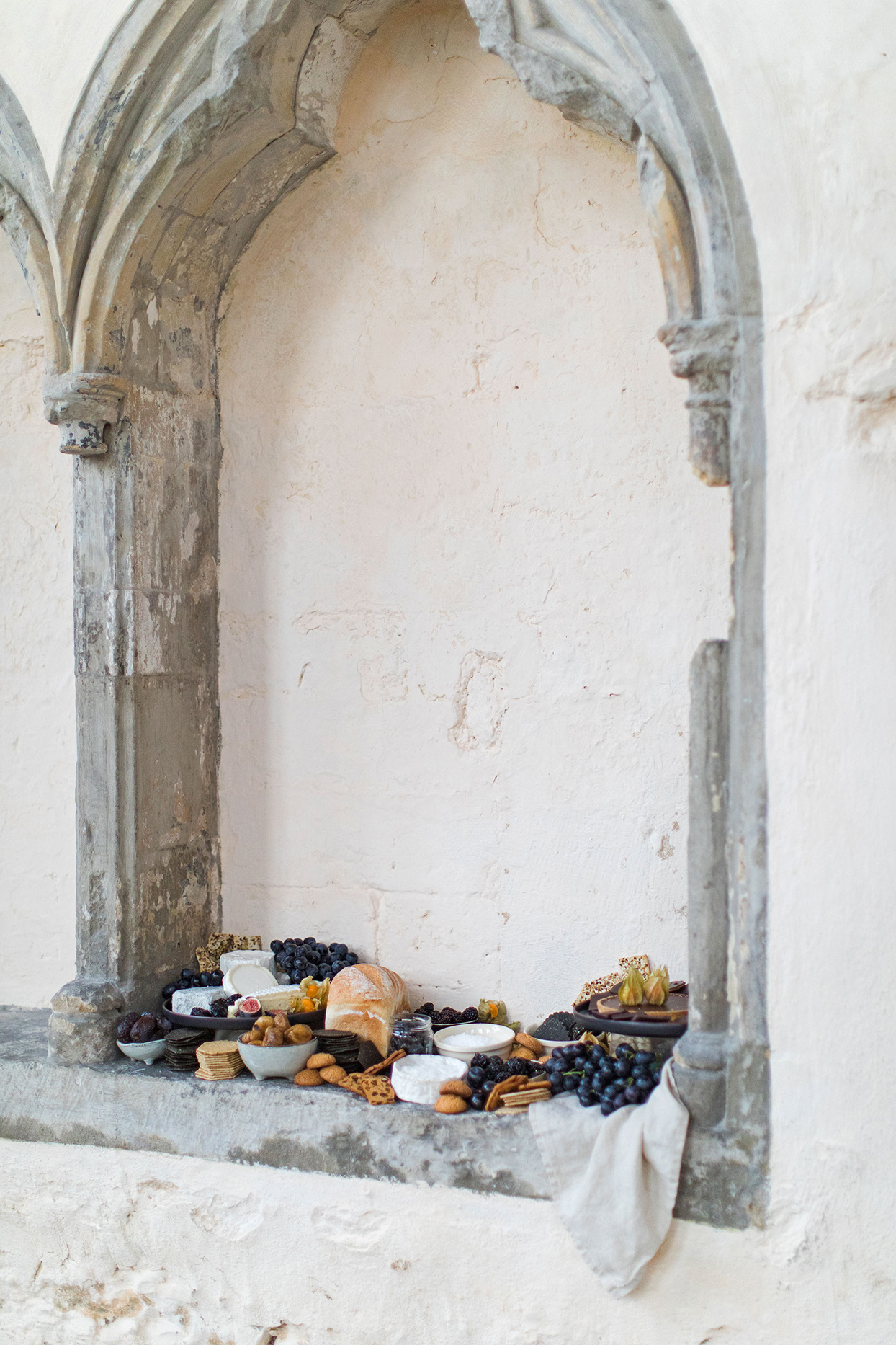 wedding grazing table perched in stone window frame