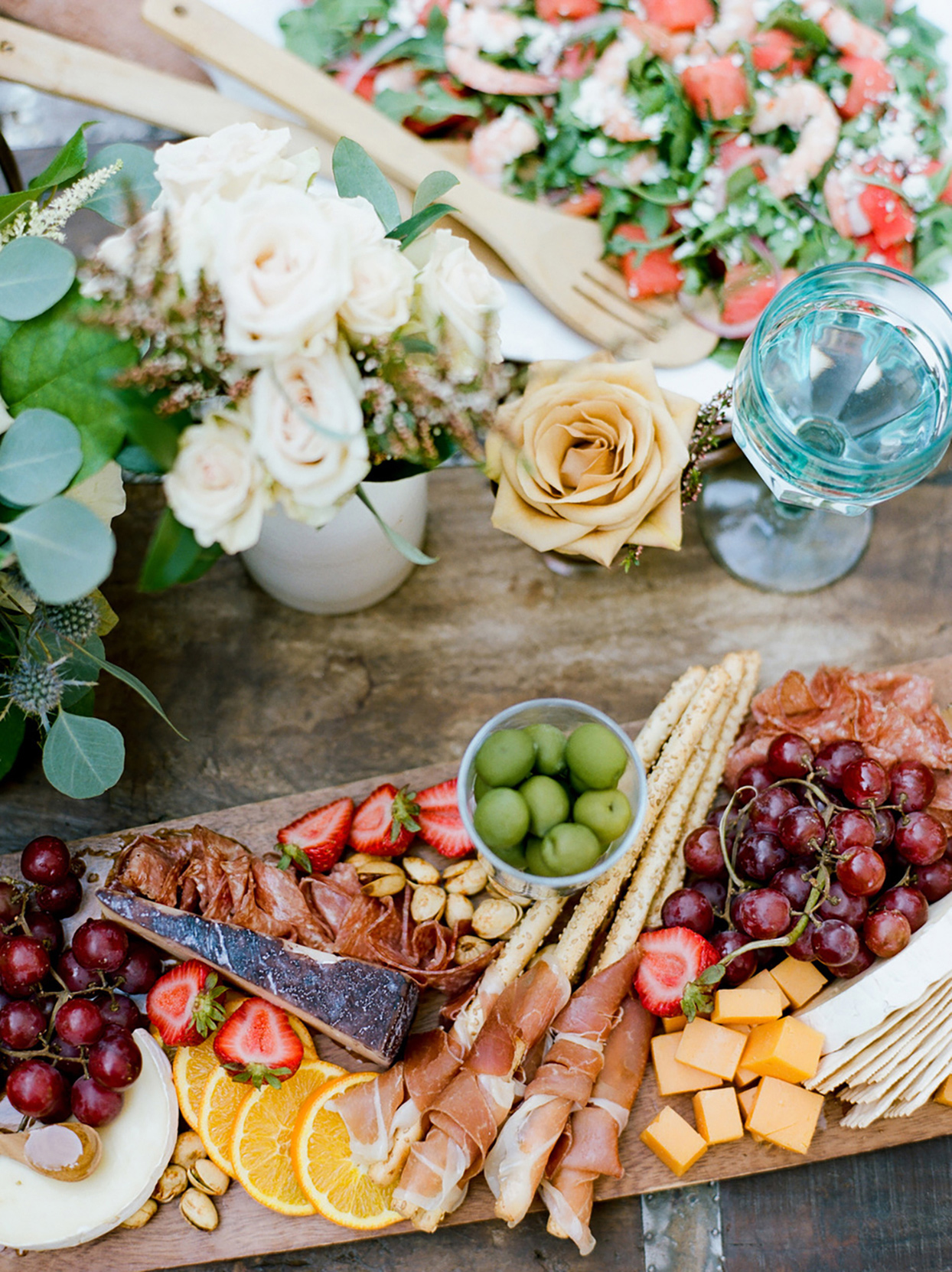 wedding grazing board with cheese, meat, and fruit