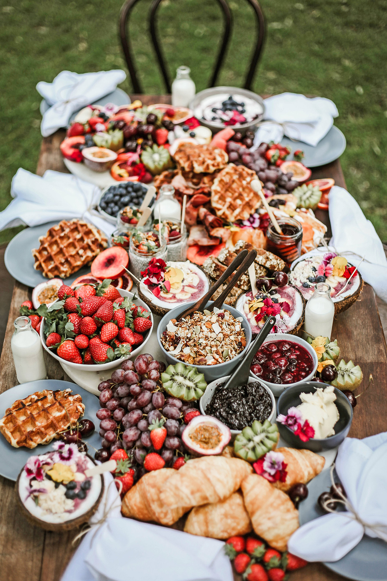 wedding grazing board breakfast buffet with fruit, waffles, croissants