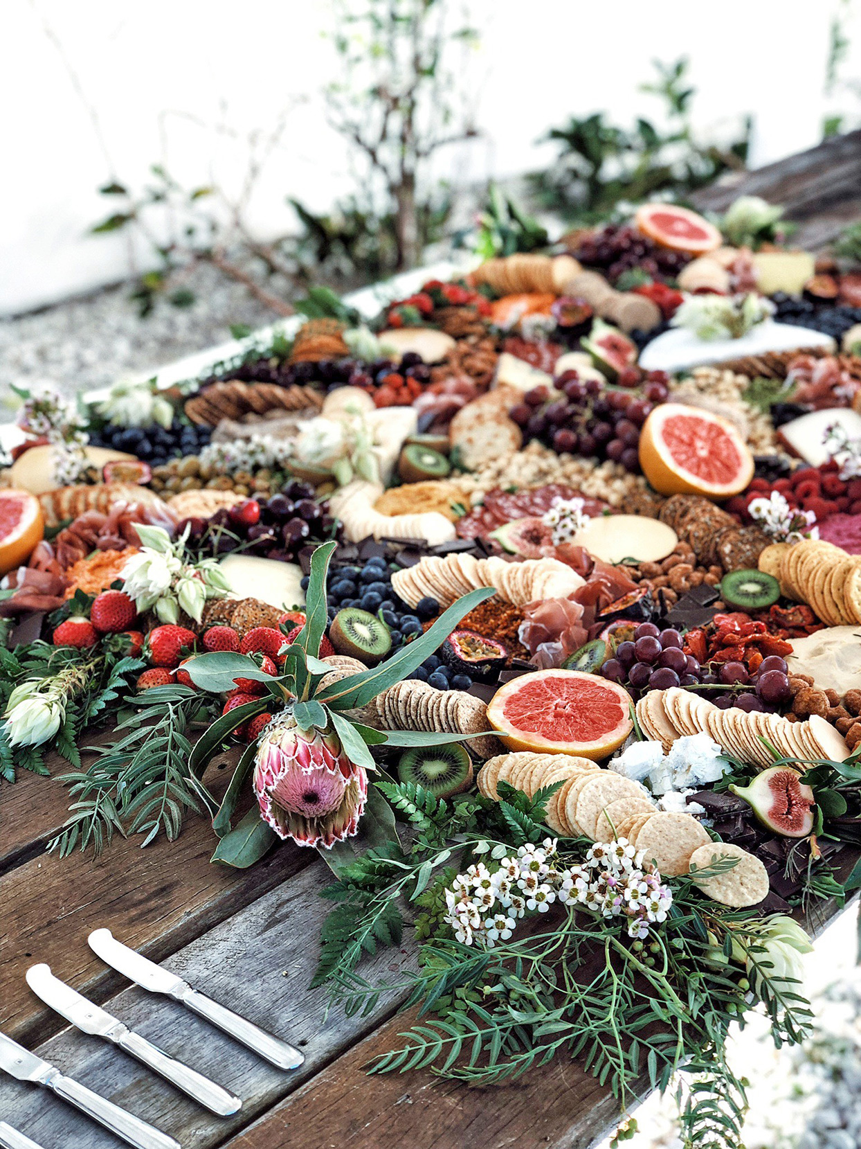 wedding grazing board filled with fruit, crackers, and cheese