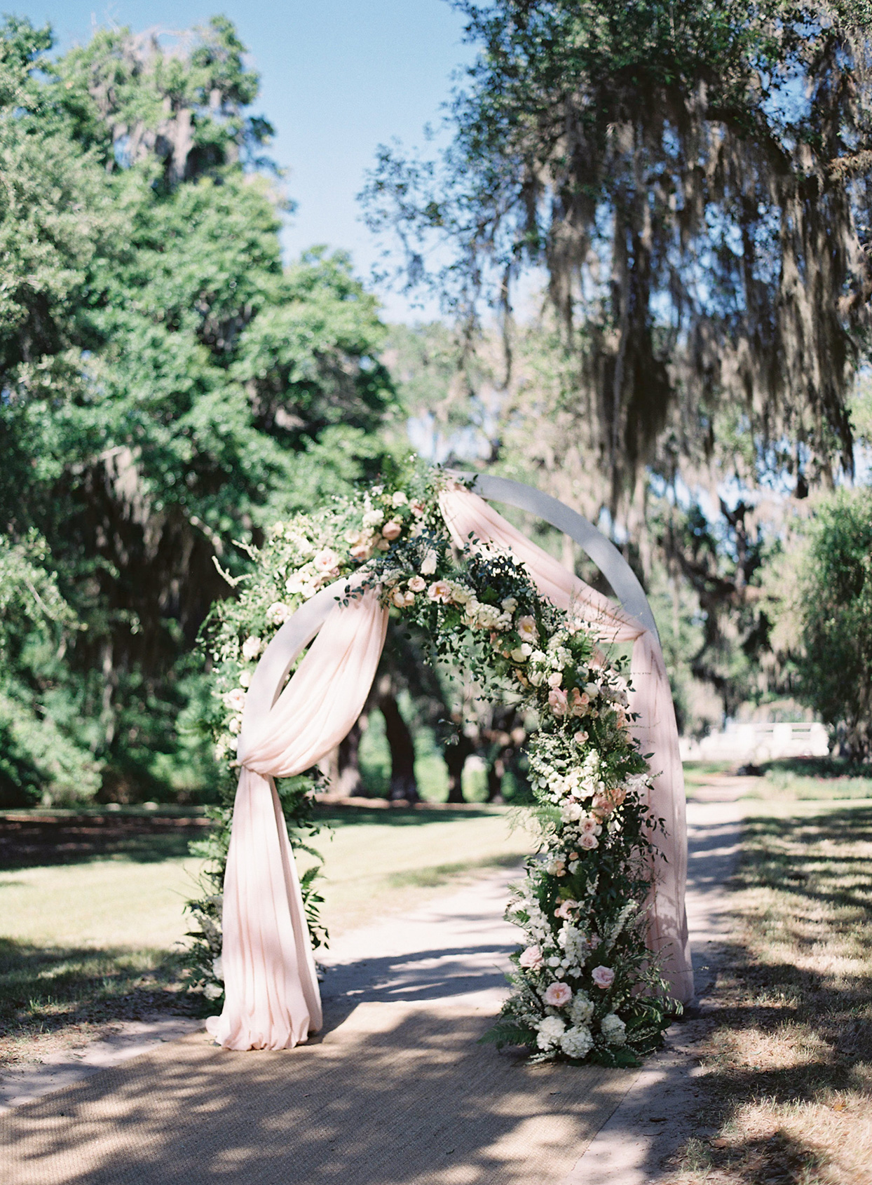 chelsea john wedding ceremony arch on dirt road