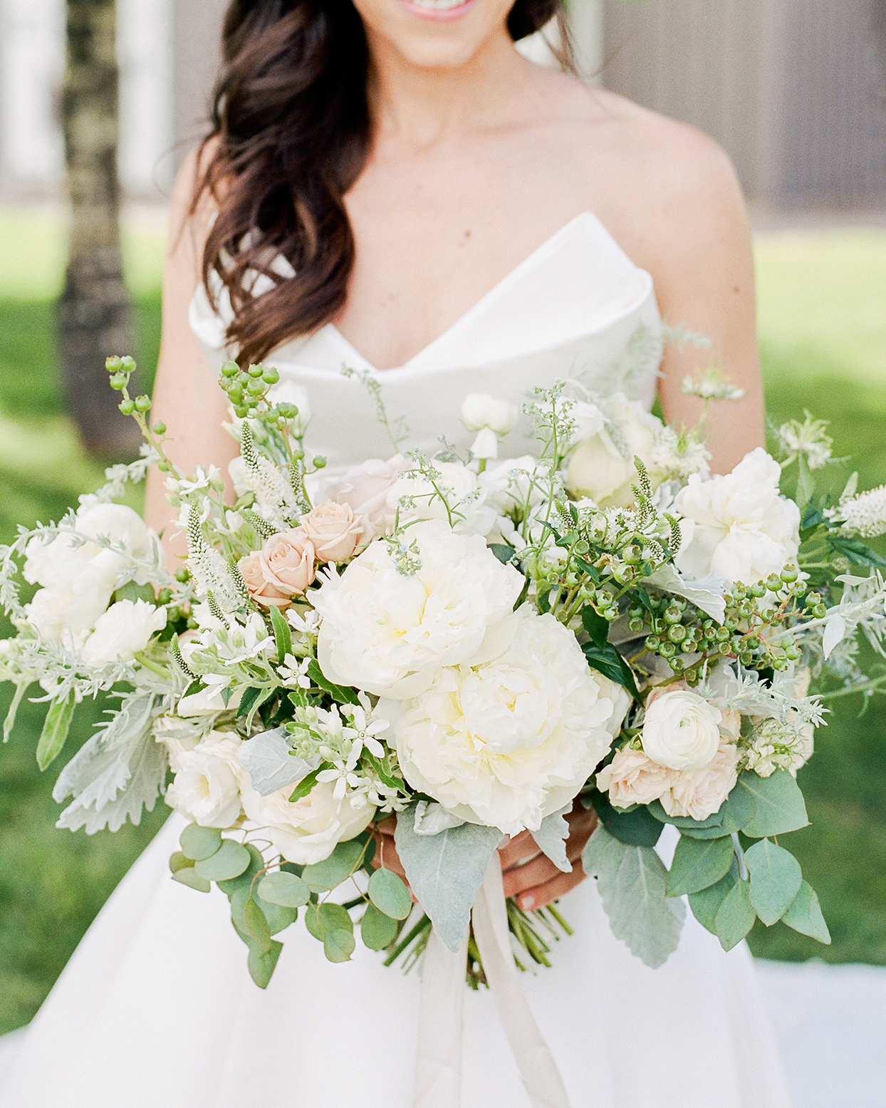 jessica aaron bride holding white wedding bouquet