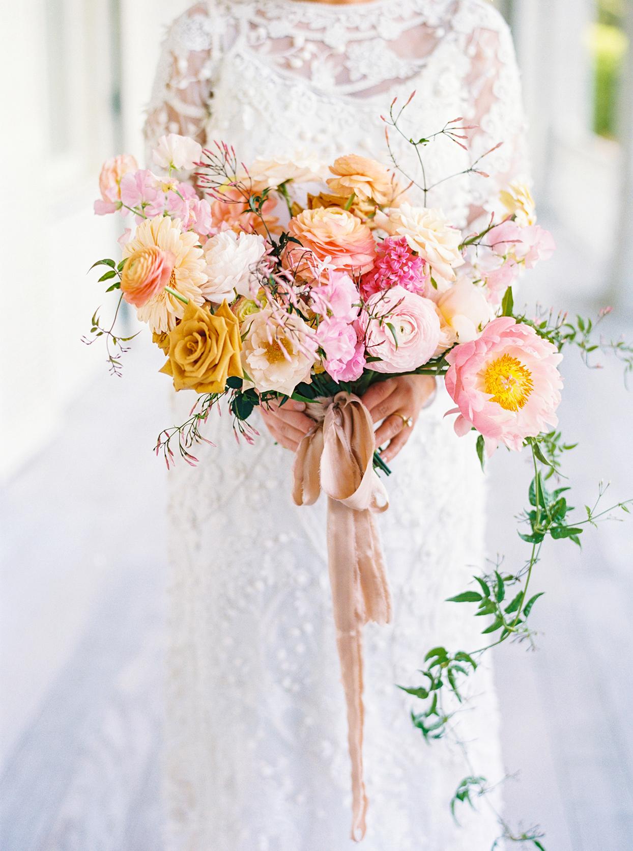 lauren dan pink, yellow, and orange wedding bouquet