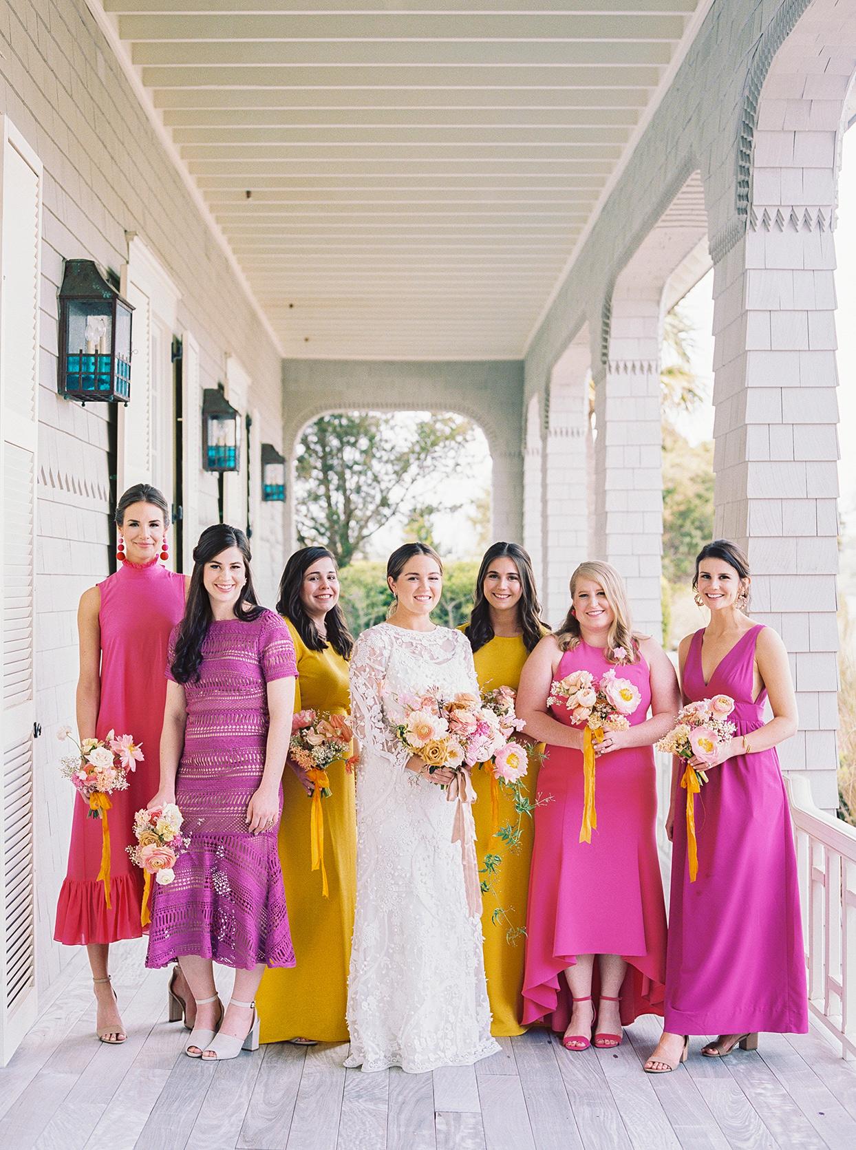 lauren dan wedding bridesmaids in colorful yellow and pink dresses