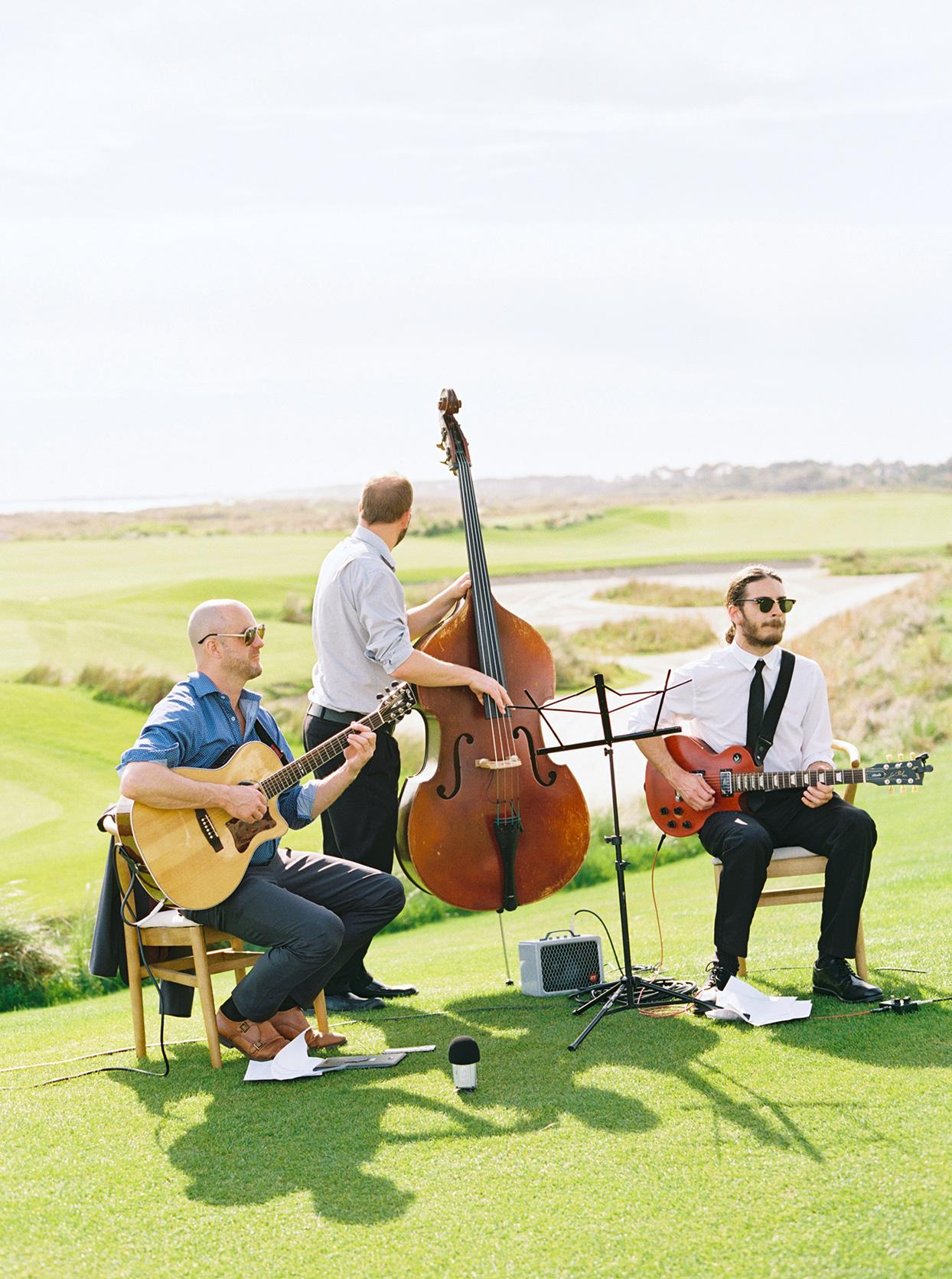 lauren dan wedding ceremony musicians on green grass