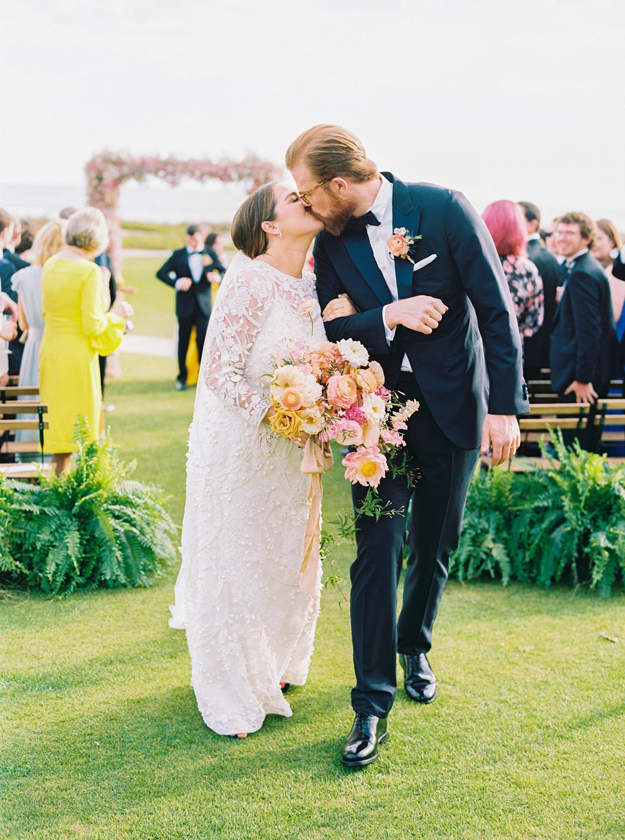 lauren dan wedding ceremony recessional kiss