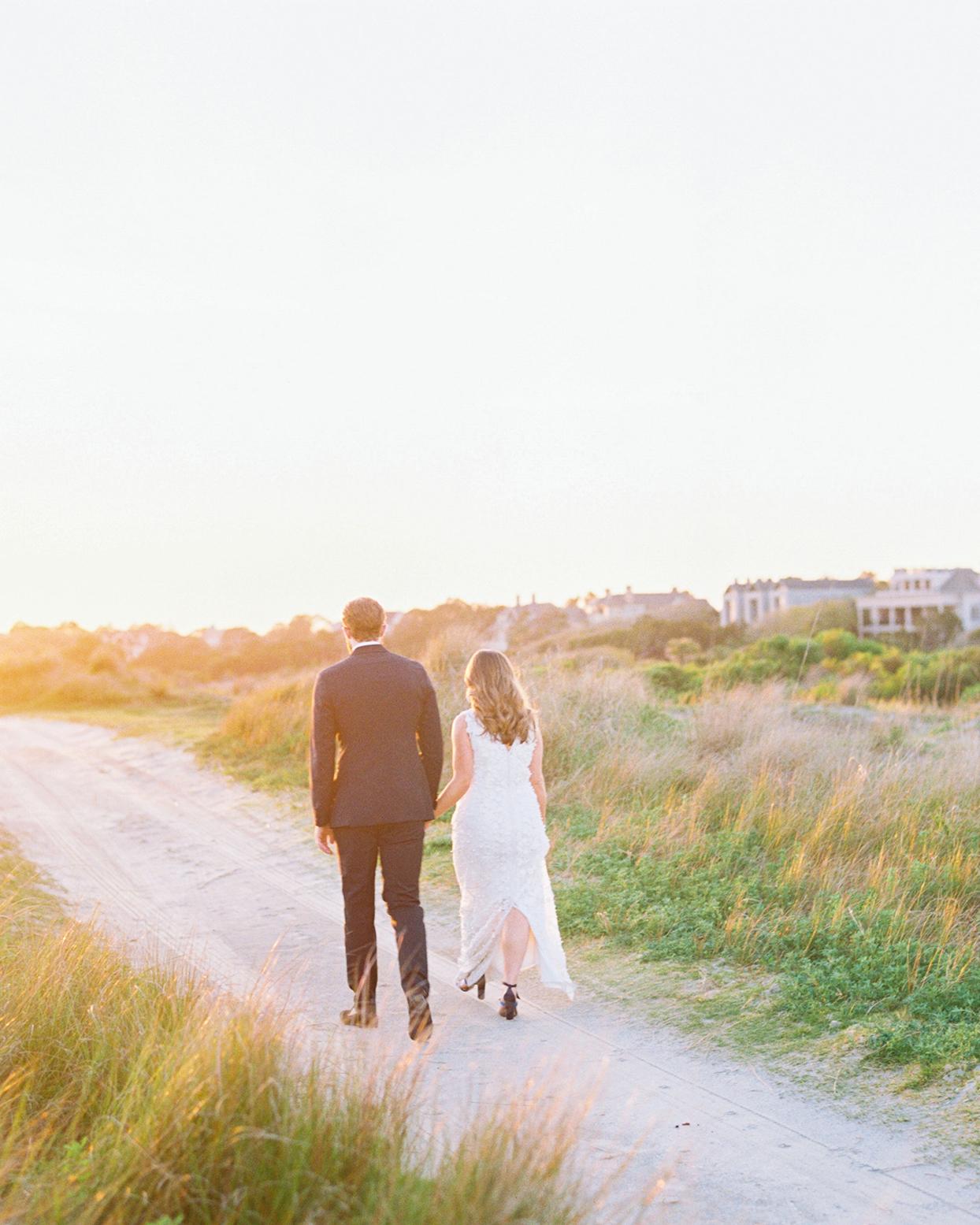 lauren dan wedding couple walking along sandy path