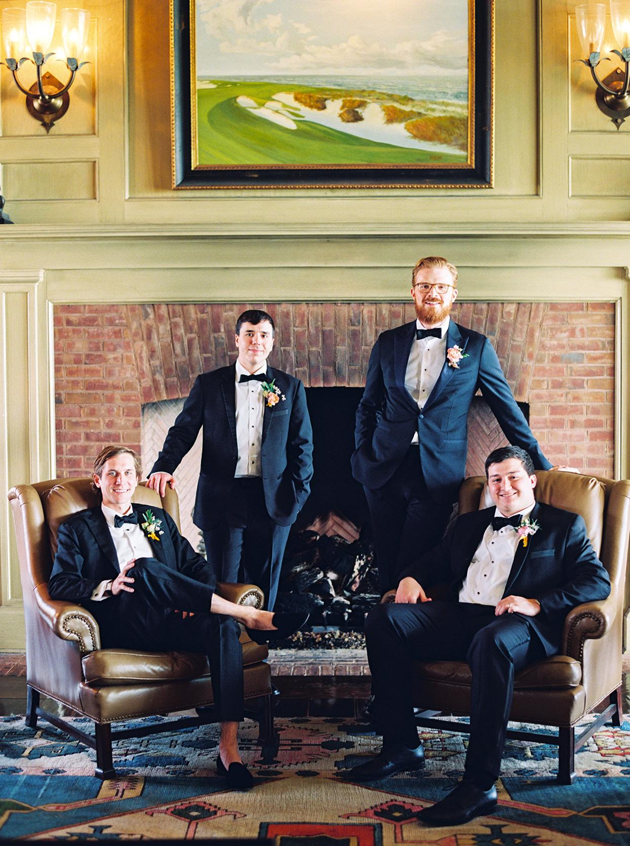 lauren dan wedding groomsmen in front of fireplace
