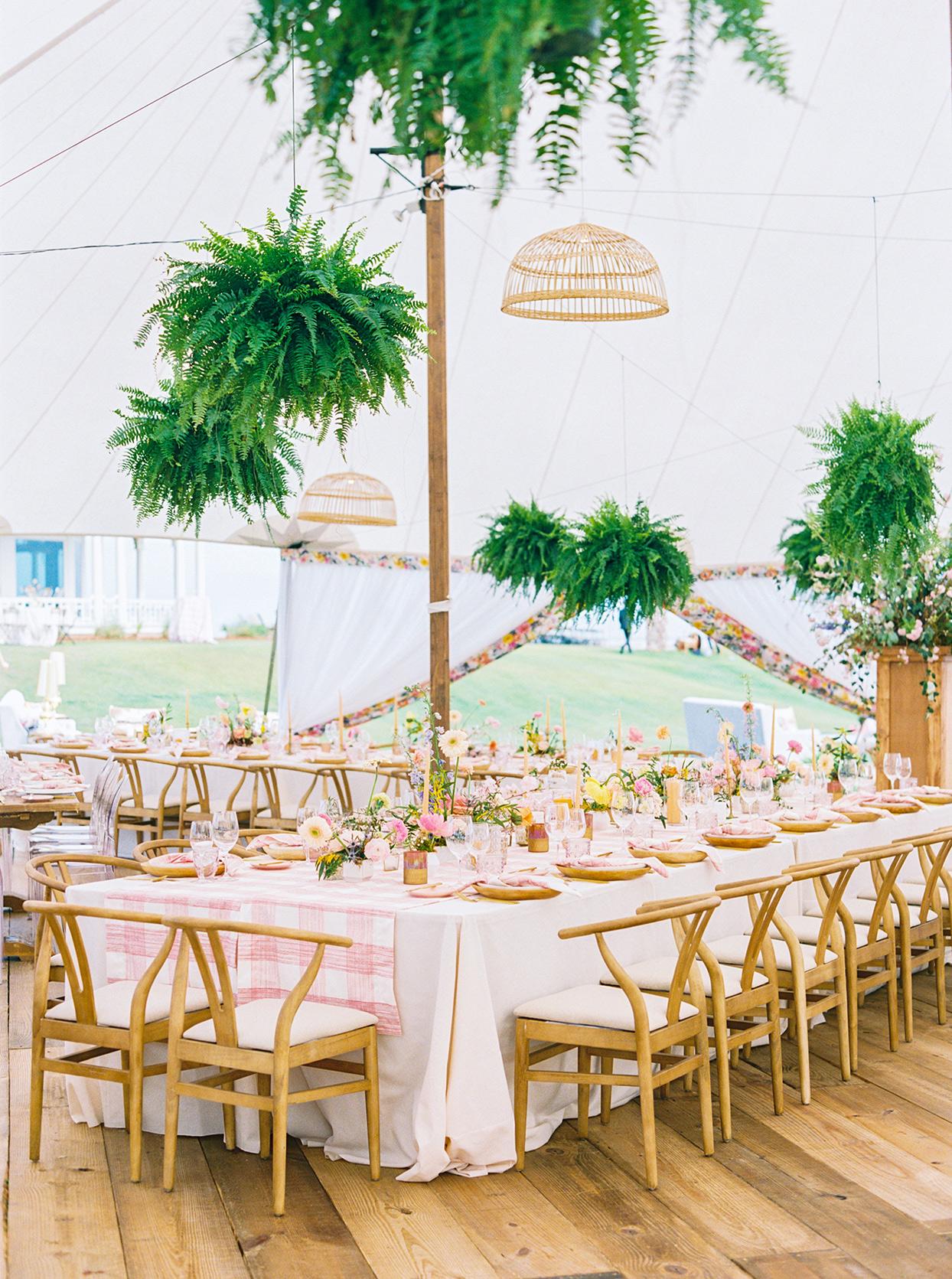 lauren dan wedding reception tables with hanging ferns