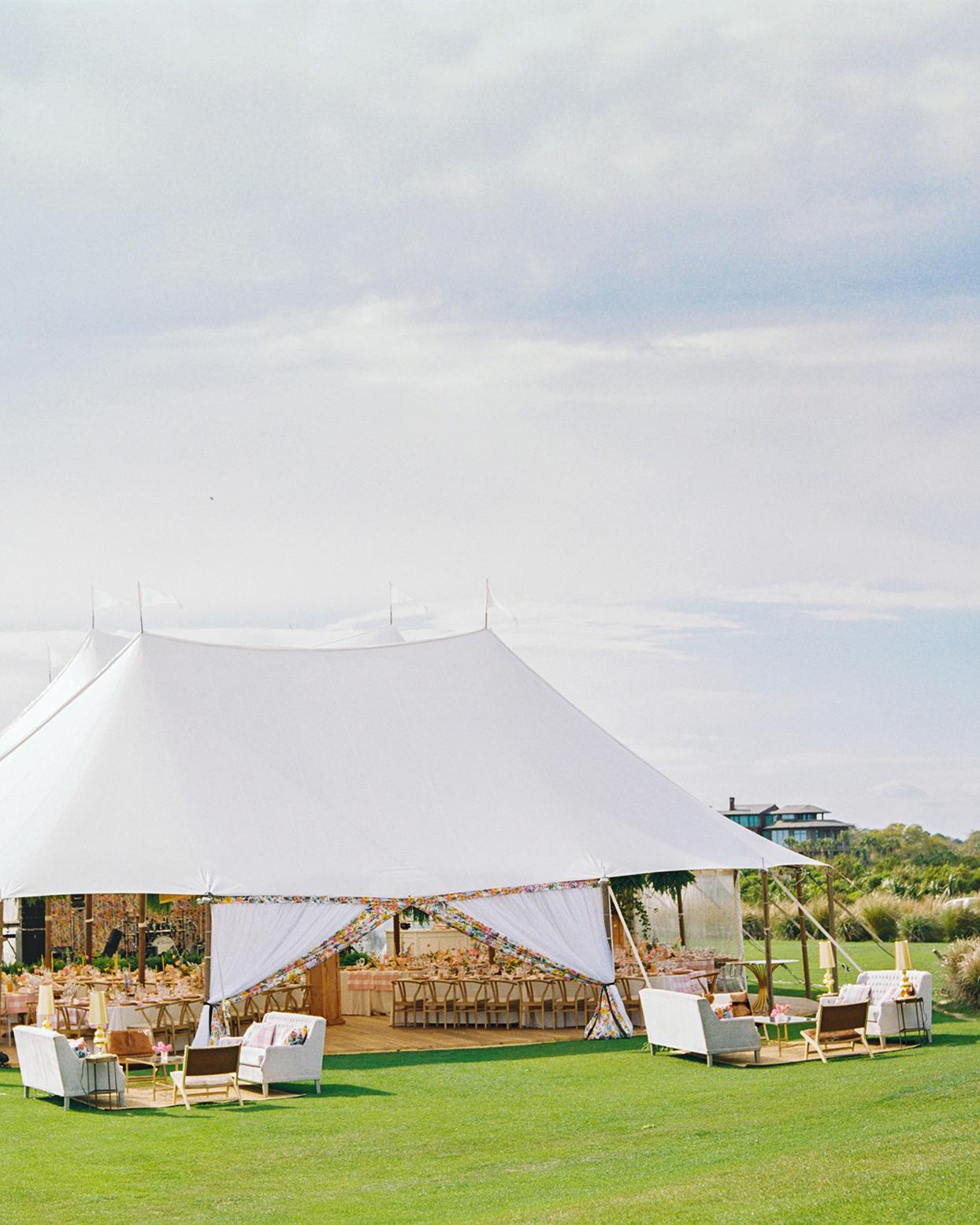 lauren dan wedding tent with wooden floor and reception tables