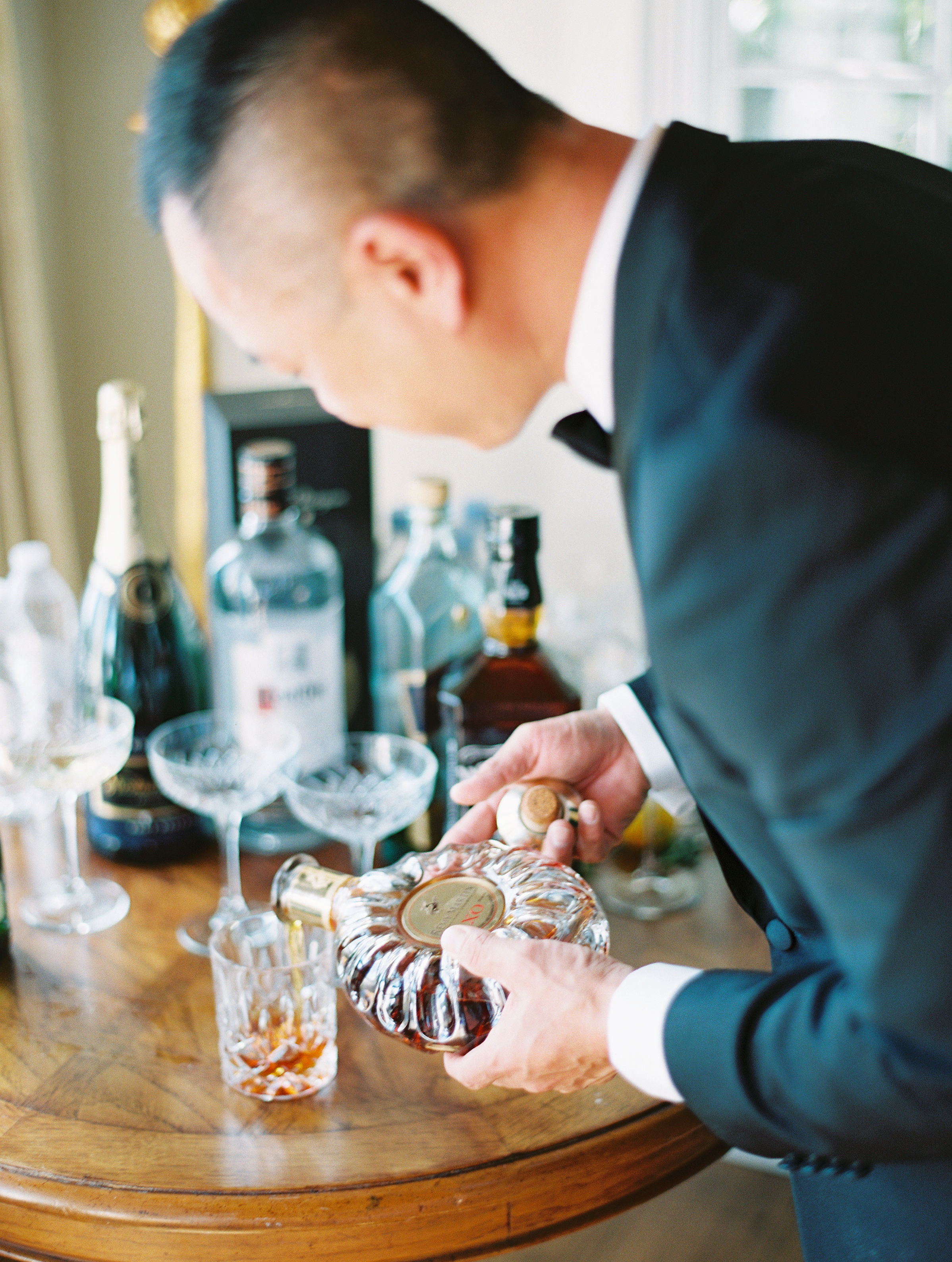 groom pouring a drink