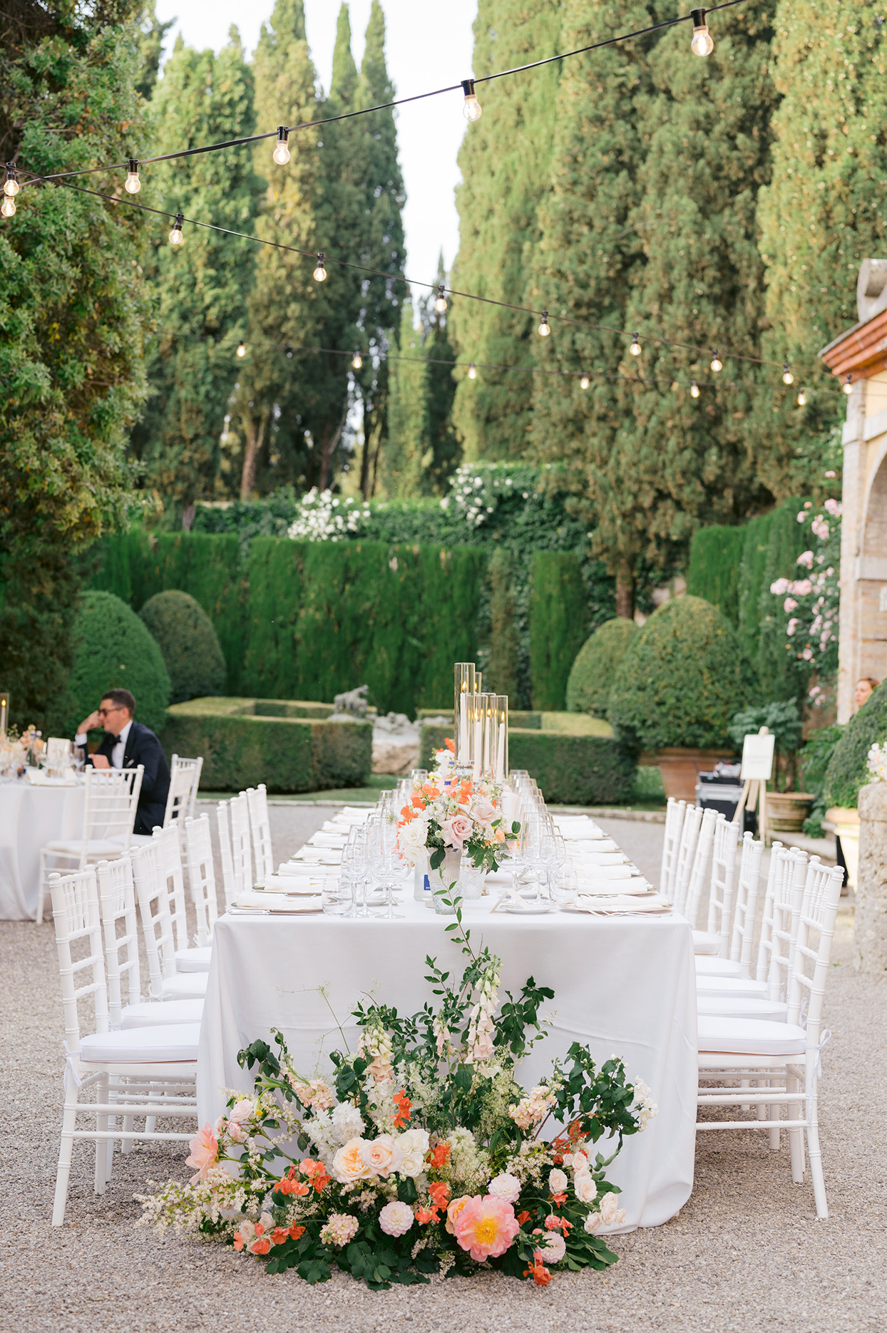 jennifer tobias wedding reception long white table with floral bouquet