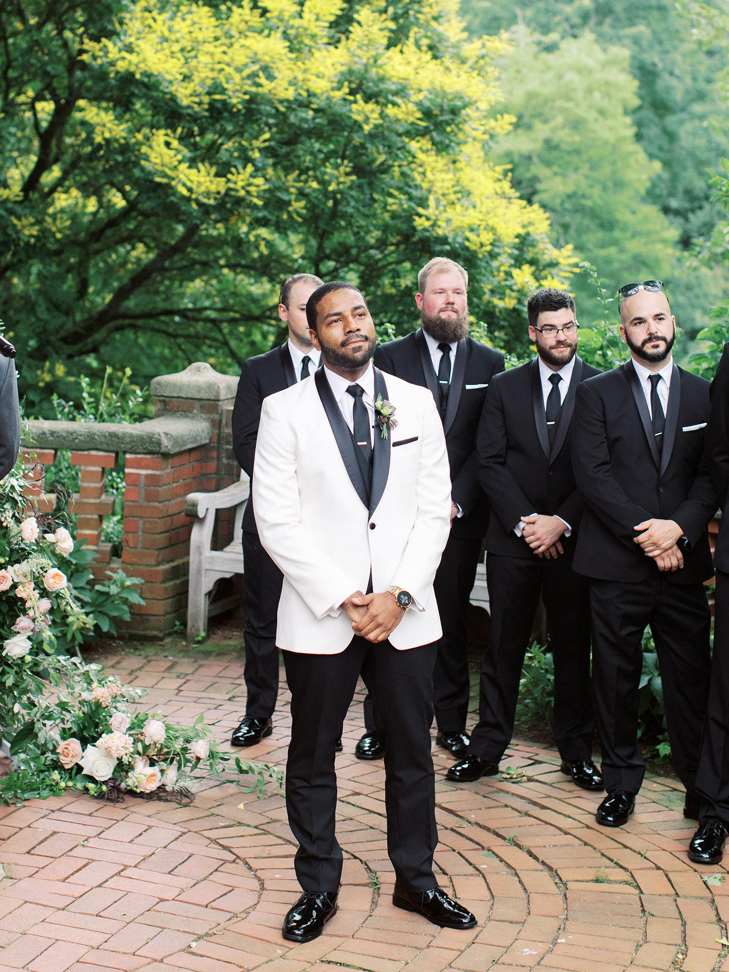 noel mike wedding groom at alter