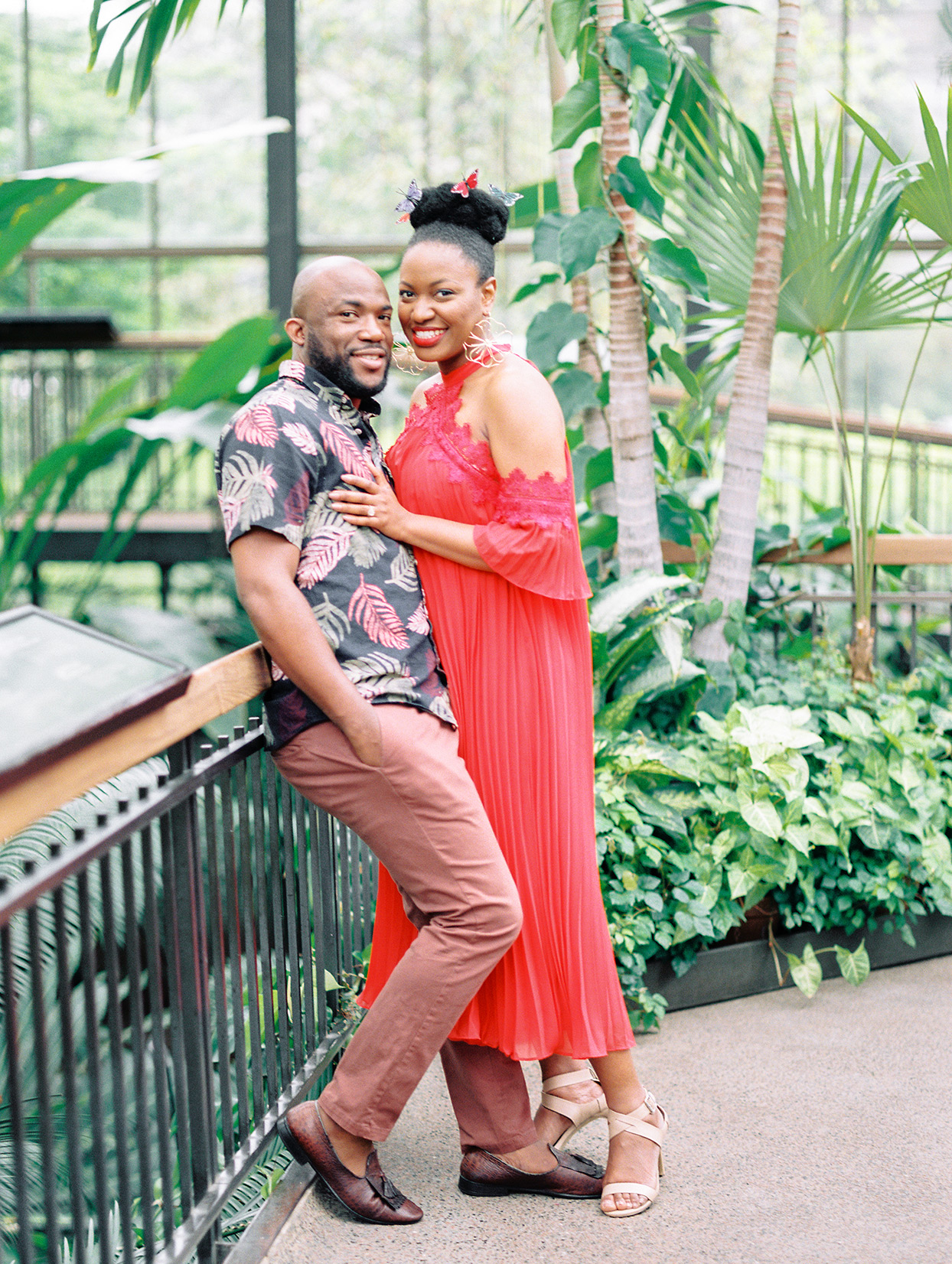 couple in botanical center wearing bold colors