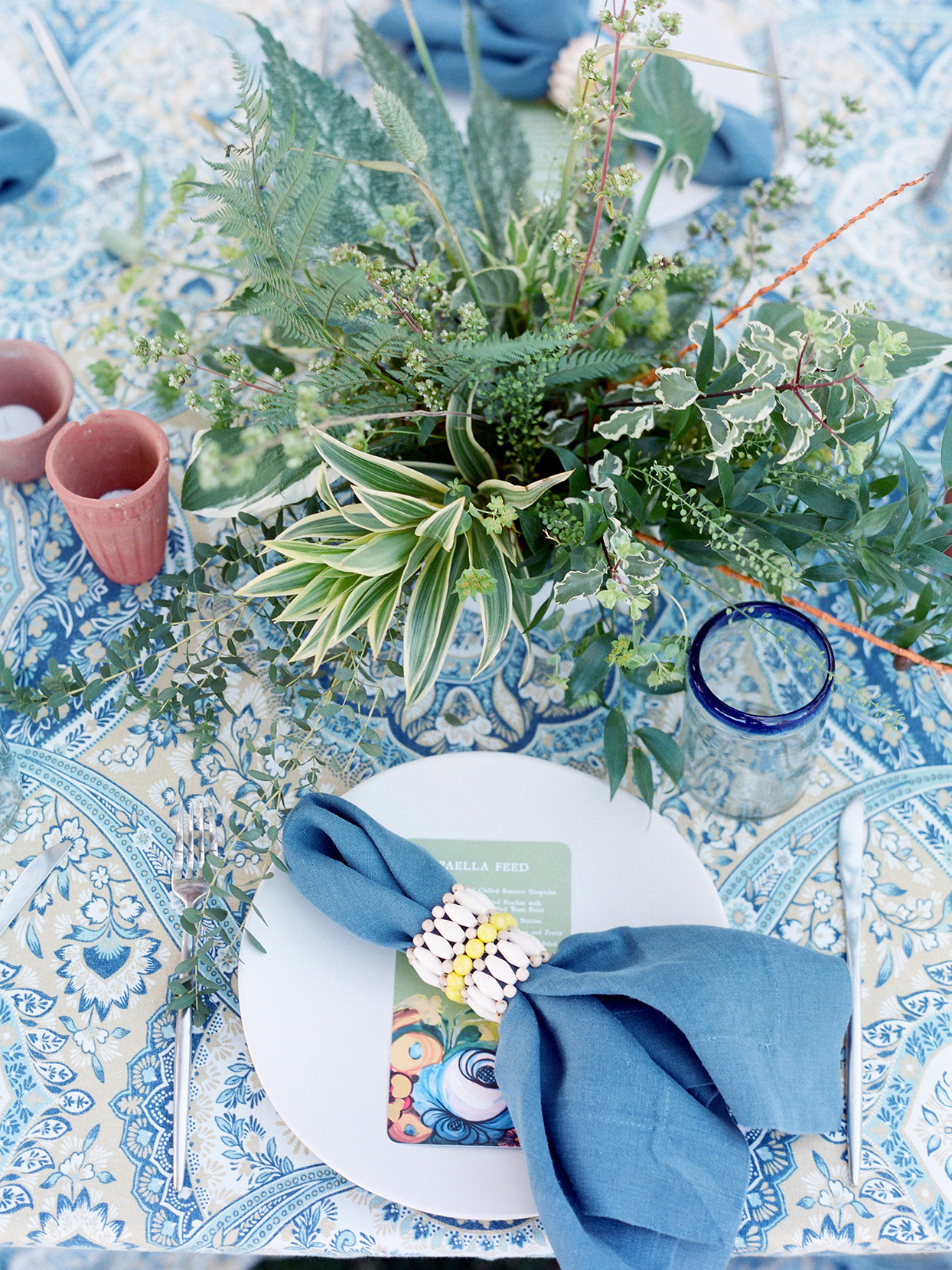 blue patterned table cloth with brunch setting