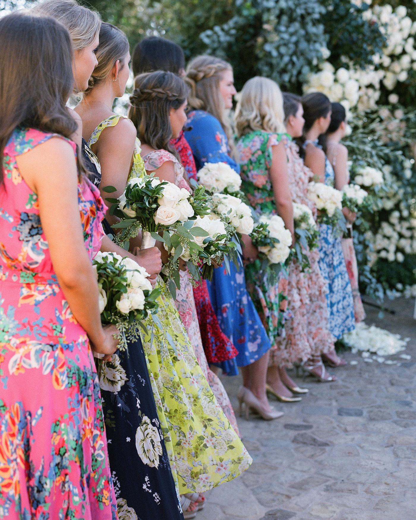 gloria's bridesmaids in colorful floral patterned dresses