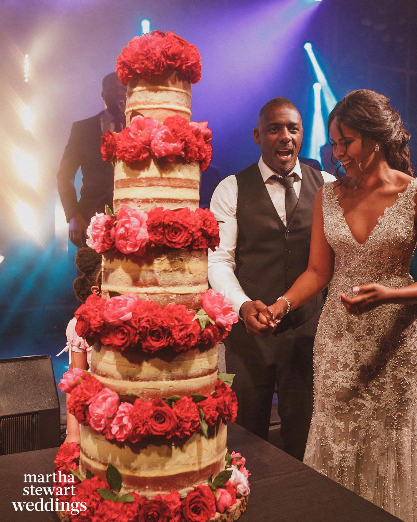 idris and sabrina elba cutting wedding cake