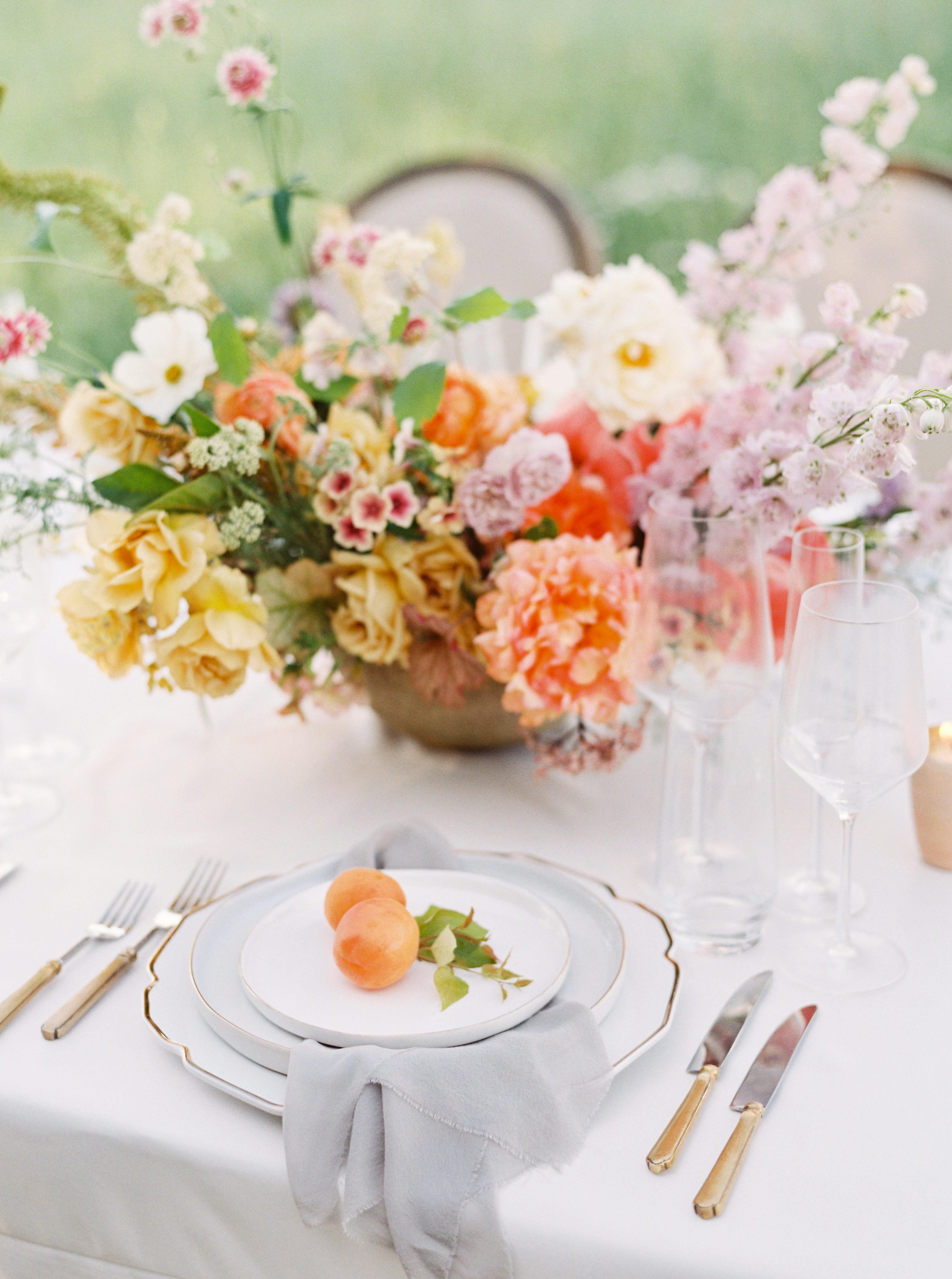 summer rehearsal dinner centerpiece with pastel flowers