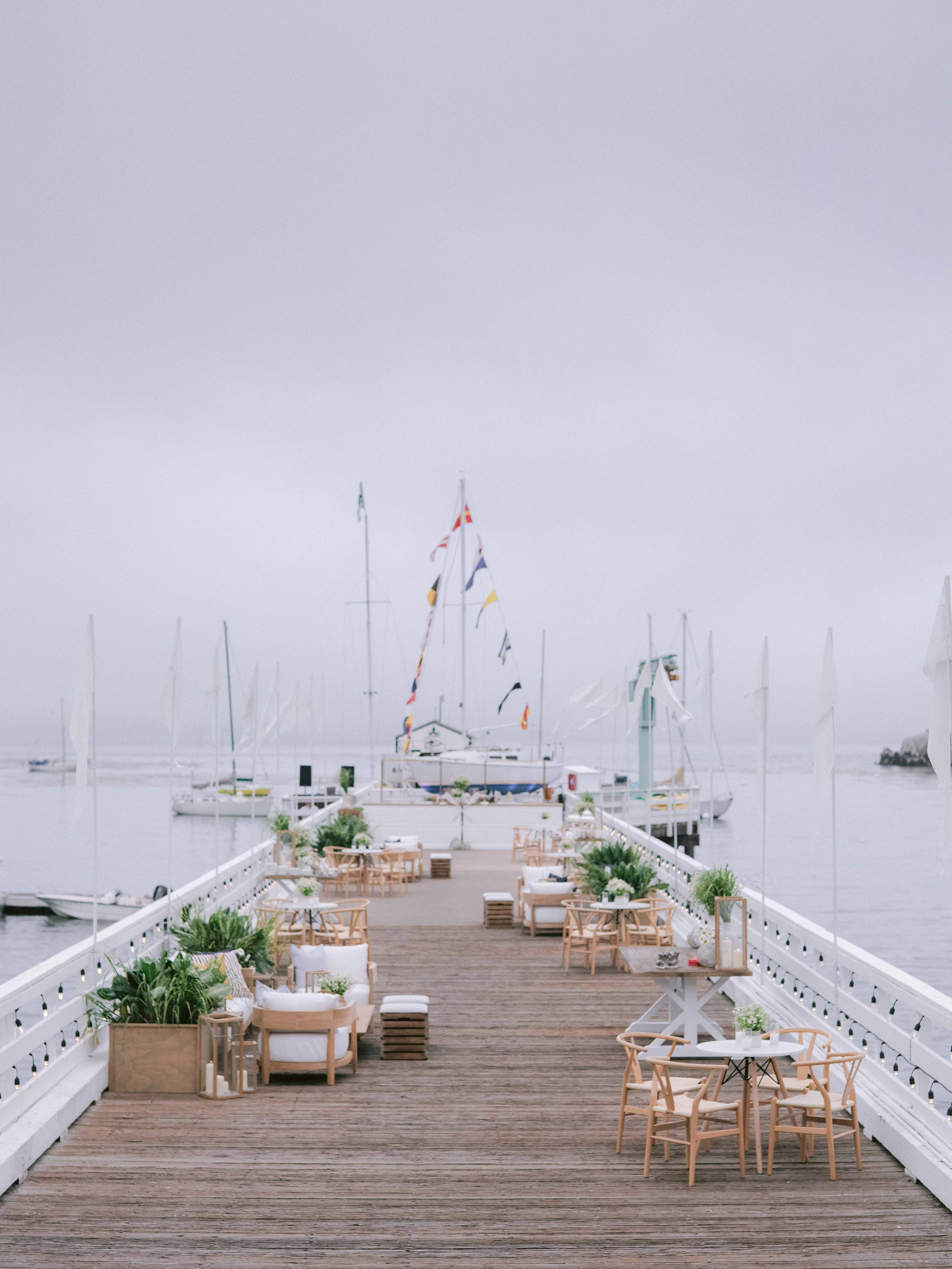 intimate tables and chairs on marina pier