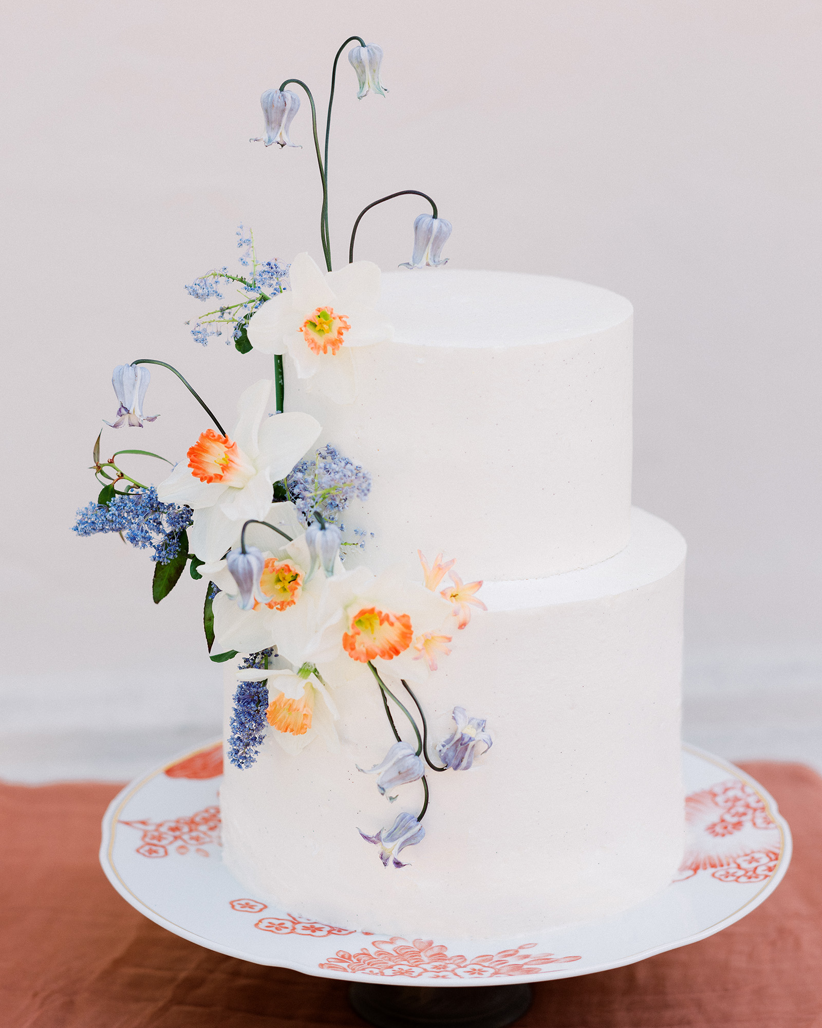 If you choose to serve a cake during your rehearsal dinner, keep it small (leave the over-the-top confection for the main event!). A fun way to make your tiny dessert feel special? Sugar flowers, like the ones on this Sheila Mae cake. Bonus points if they match the fresh florals seen throughout the party.