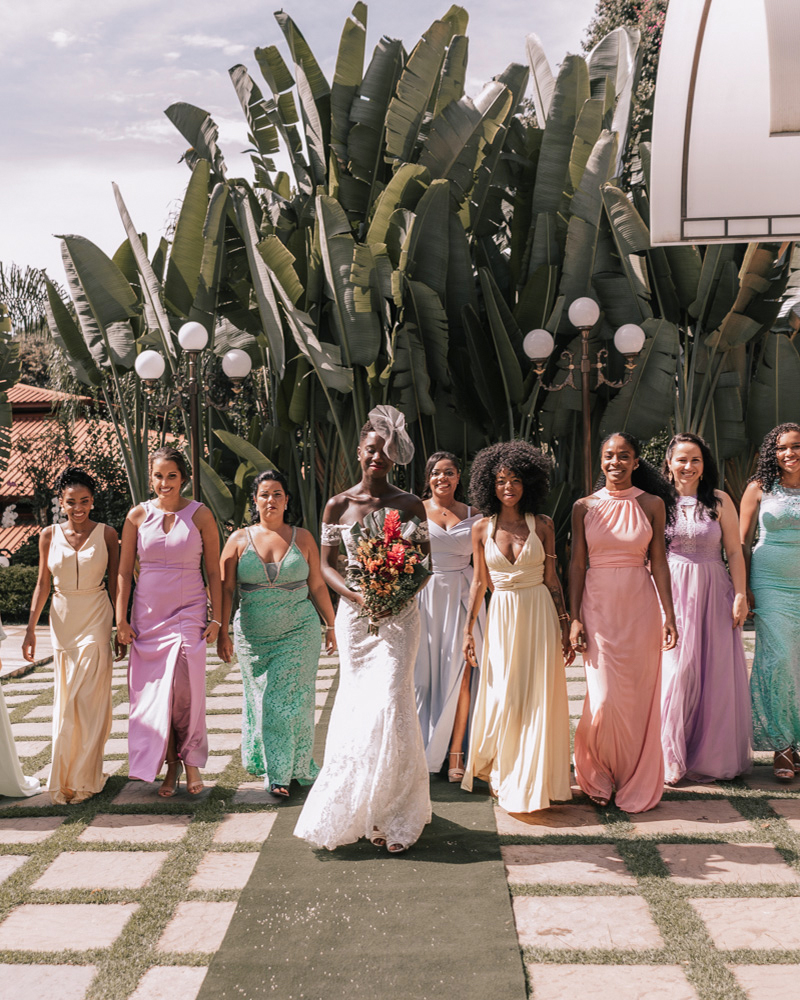 bride and bridesmaids colorful gowns