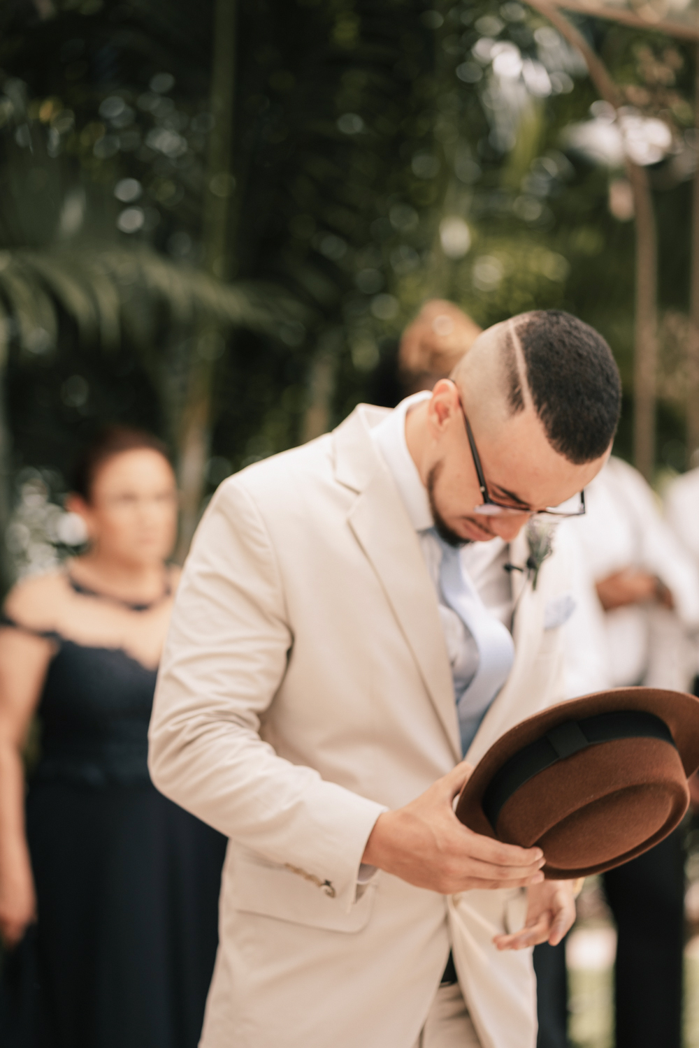 groom tipping hat wedding ceremony