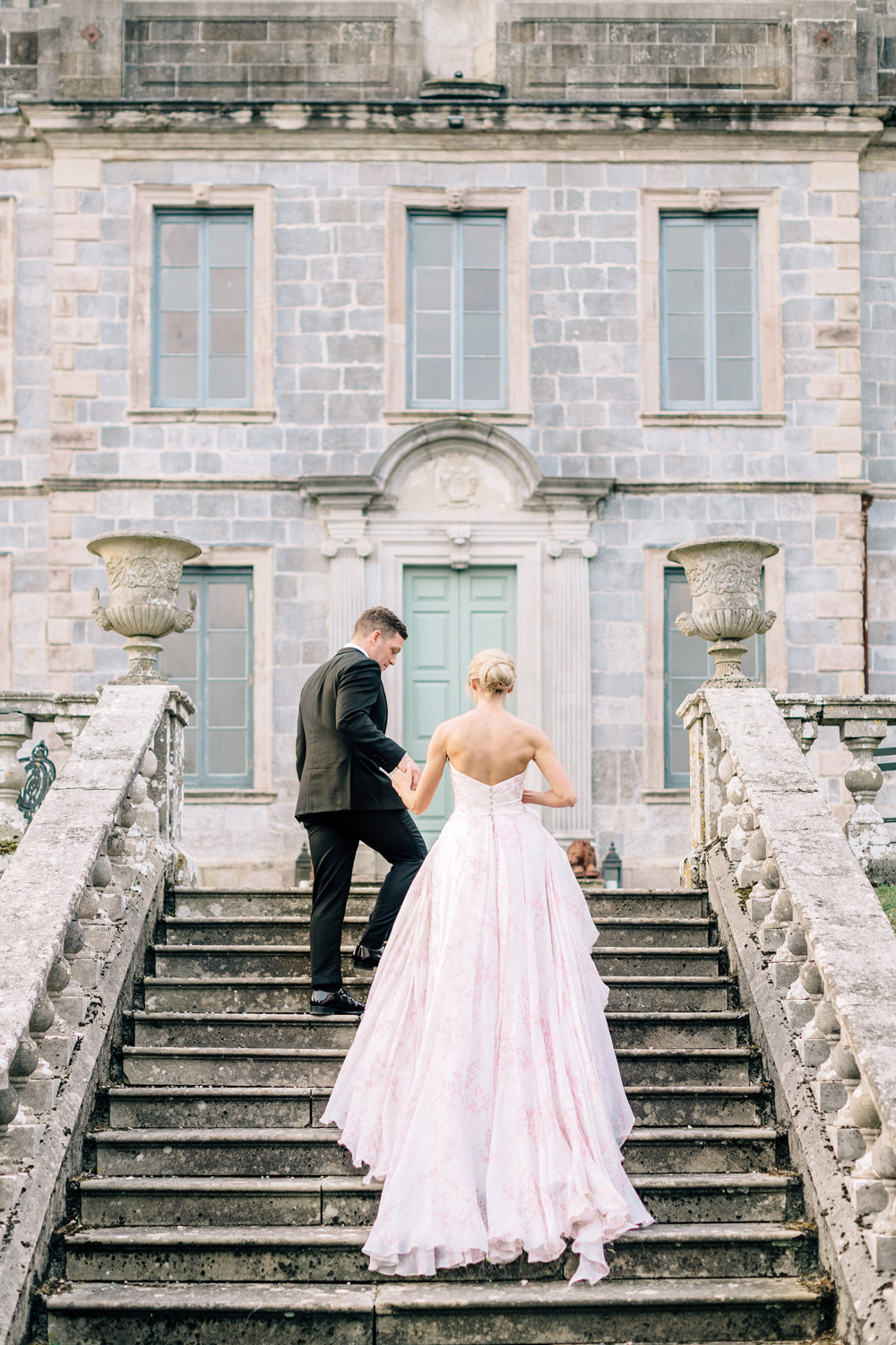 blathnaid daire wedding couple climbing stairs