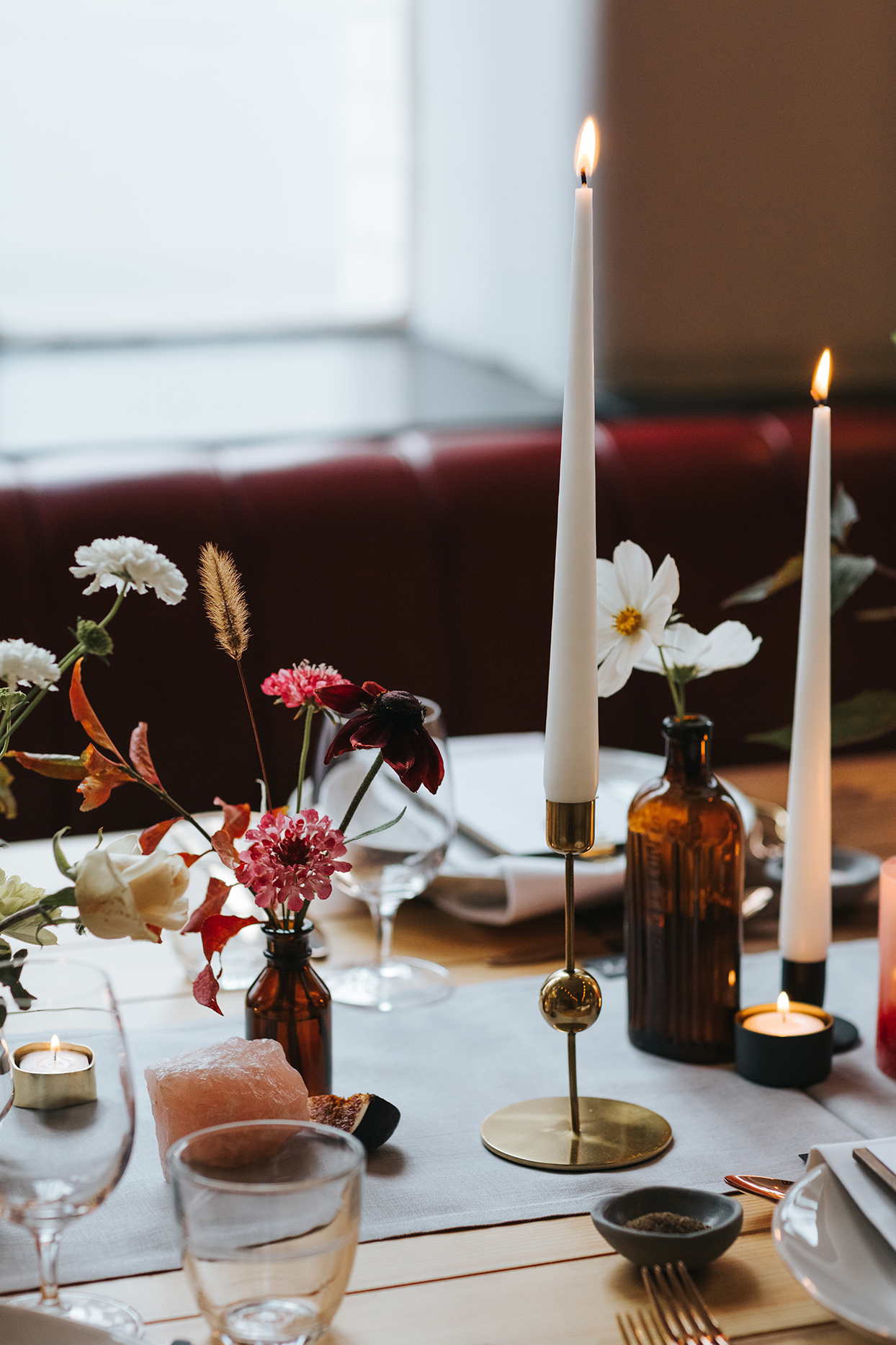 simple deep colored floral bouquets and candles on reception table