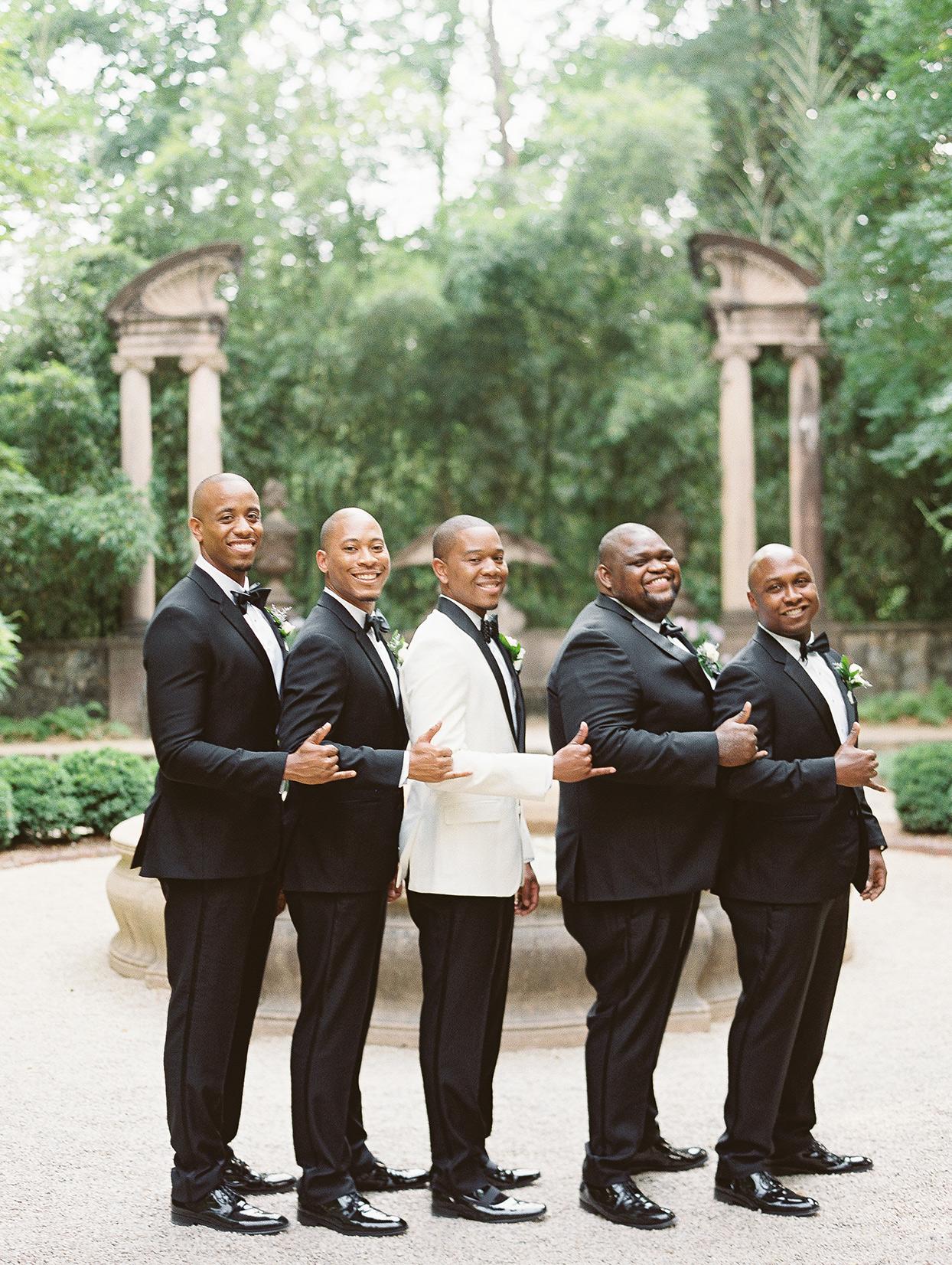 amelia justin wedding groomsmen in black