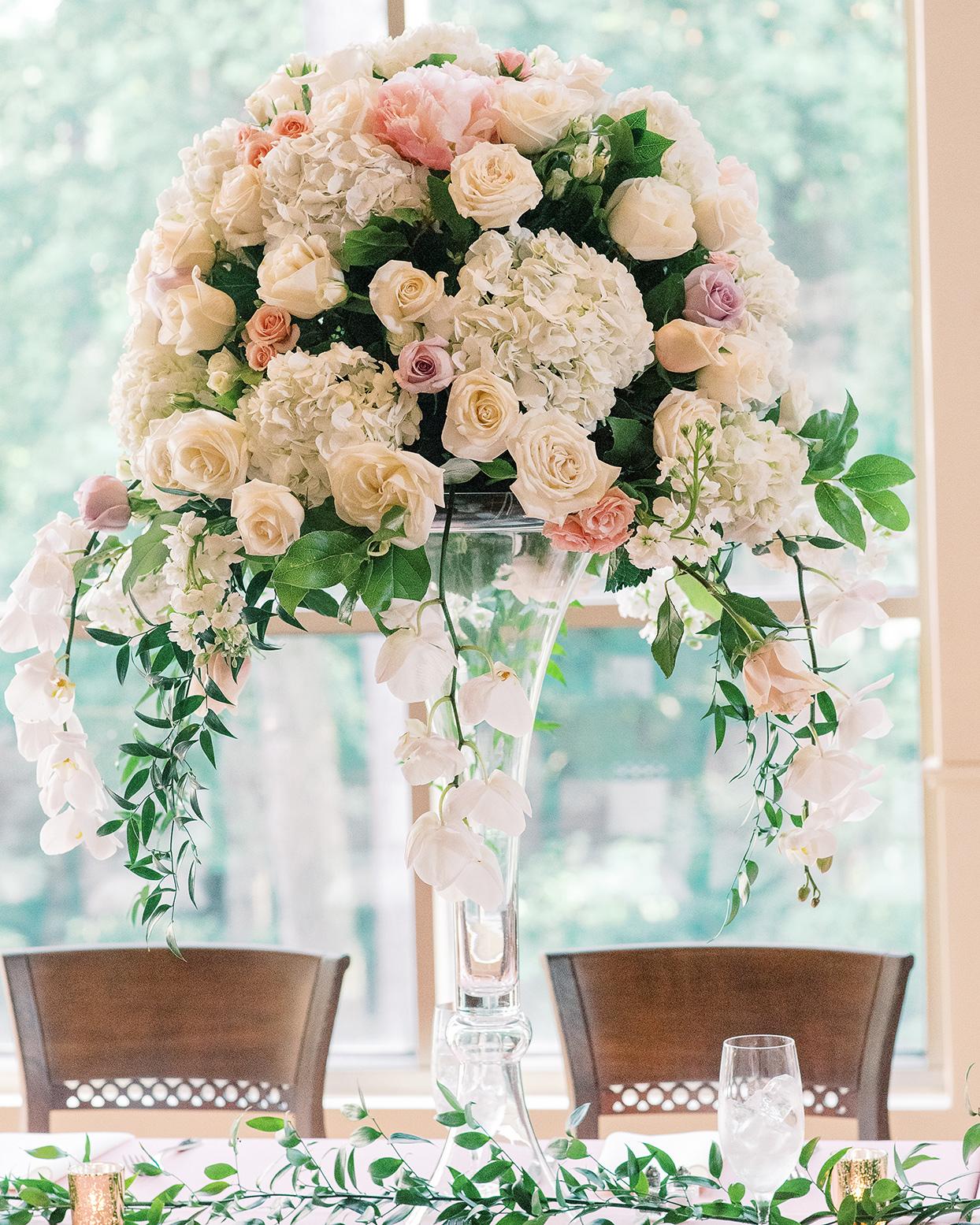 amelia justin wedding reception large floral centerpiece
