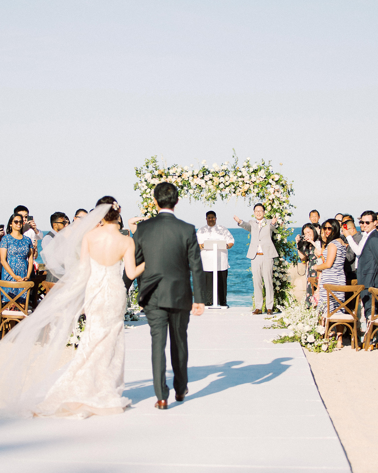 kirsten deran wedding ceremony processional on beach