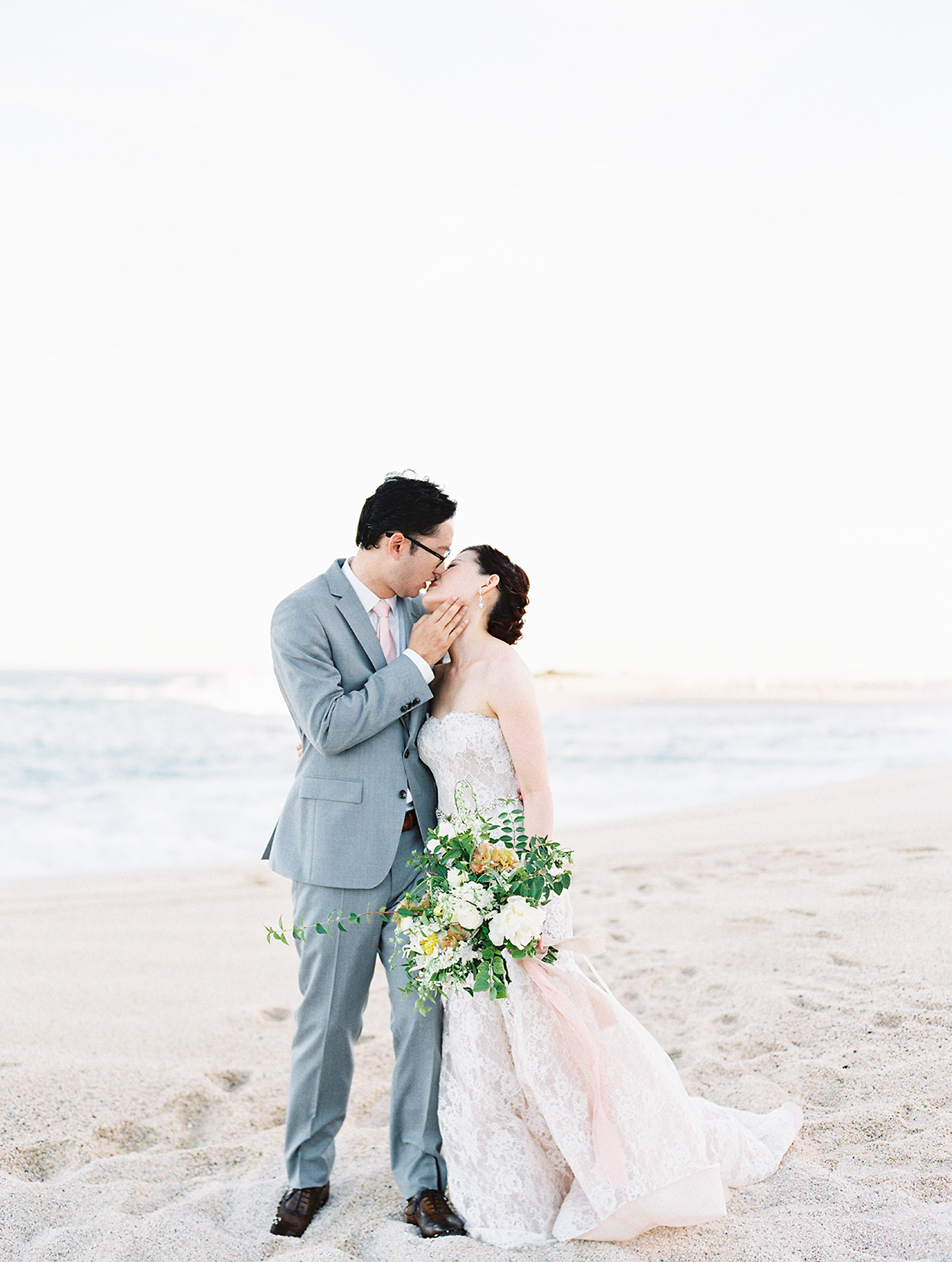 kirsten deran wedding couple kissing on beach