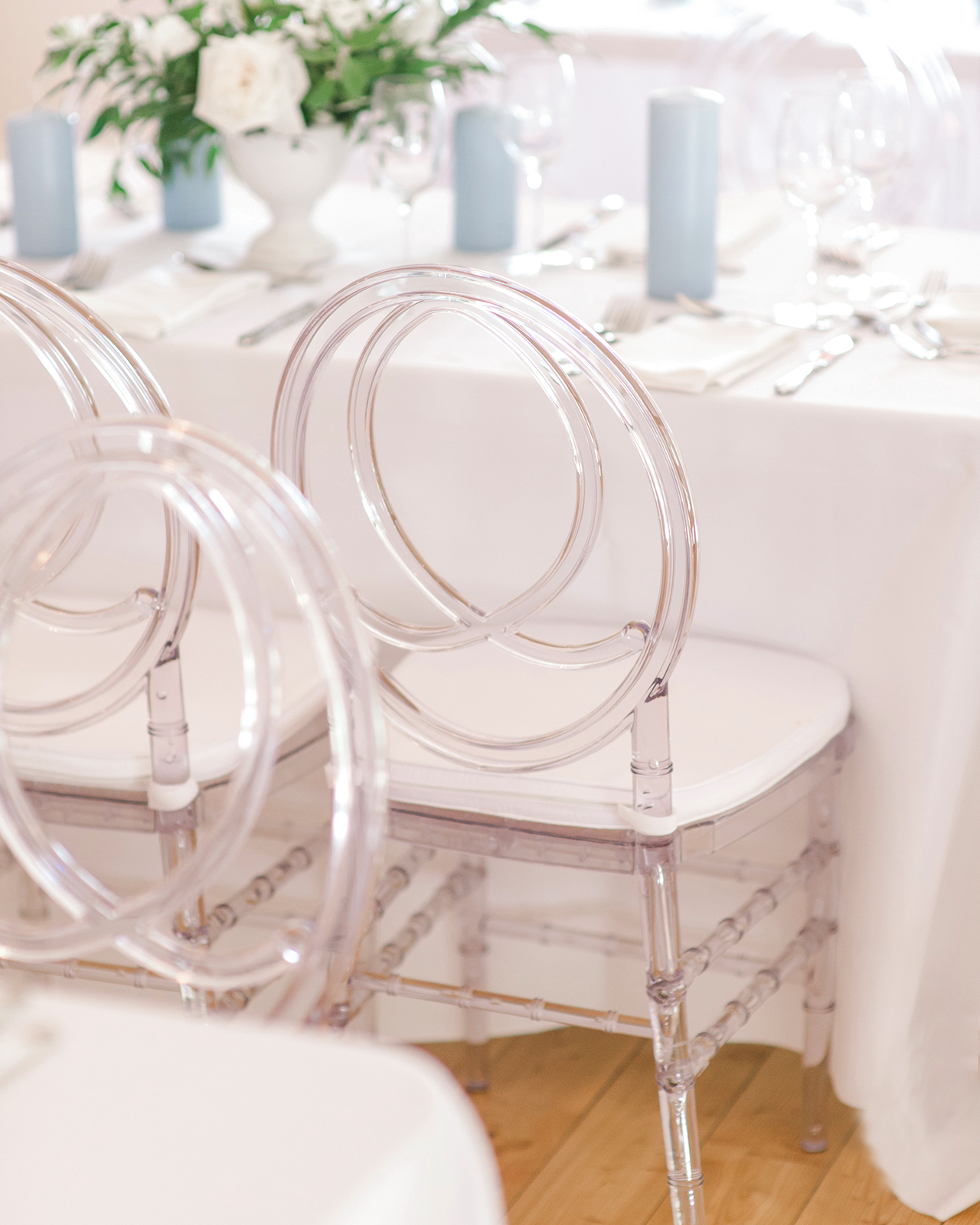 Acrylic chairs white cushions white table cloths