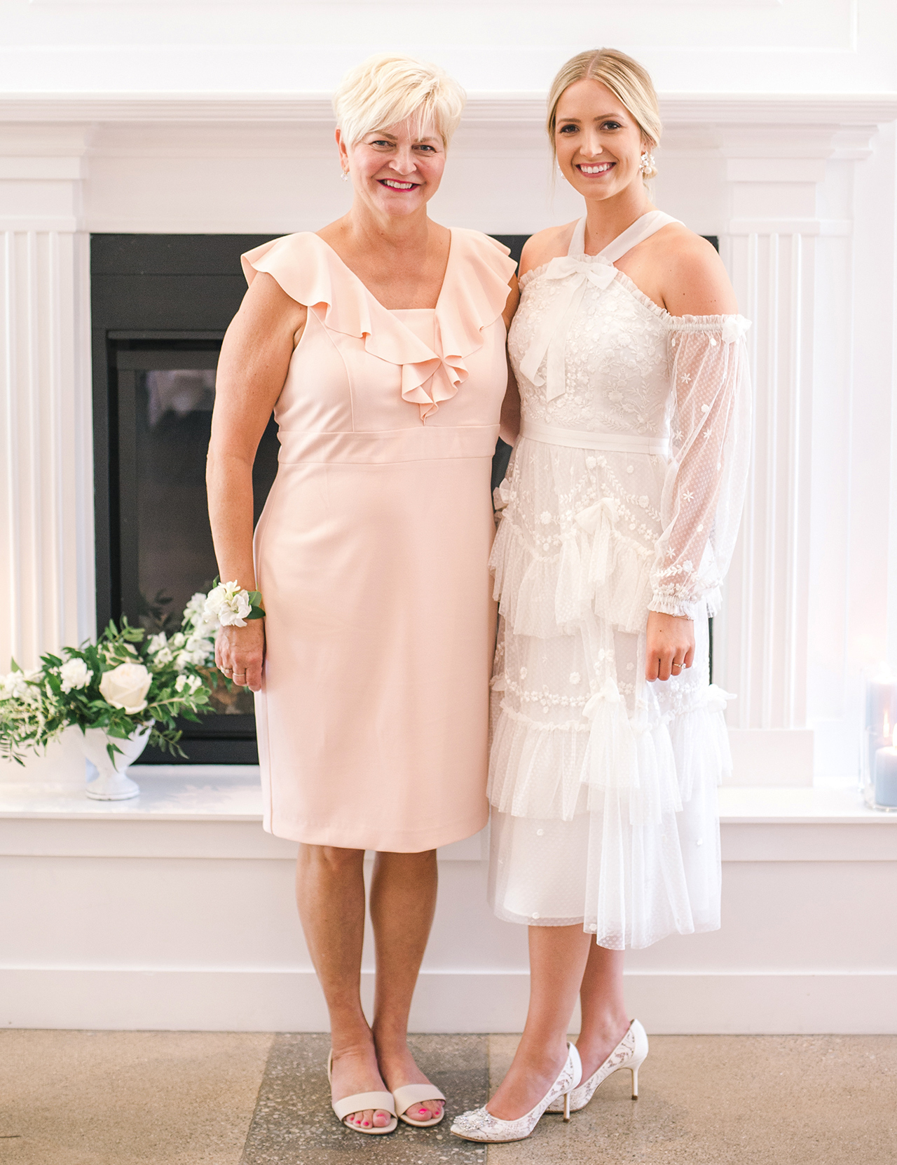 bride poses with mother in dresses bridal shower