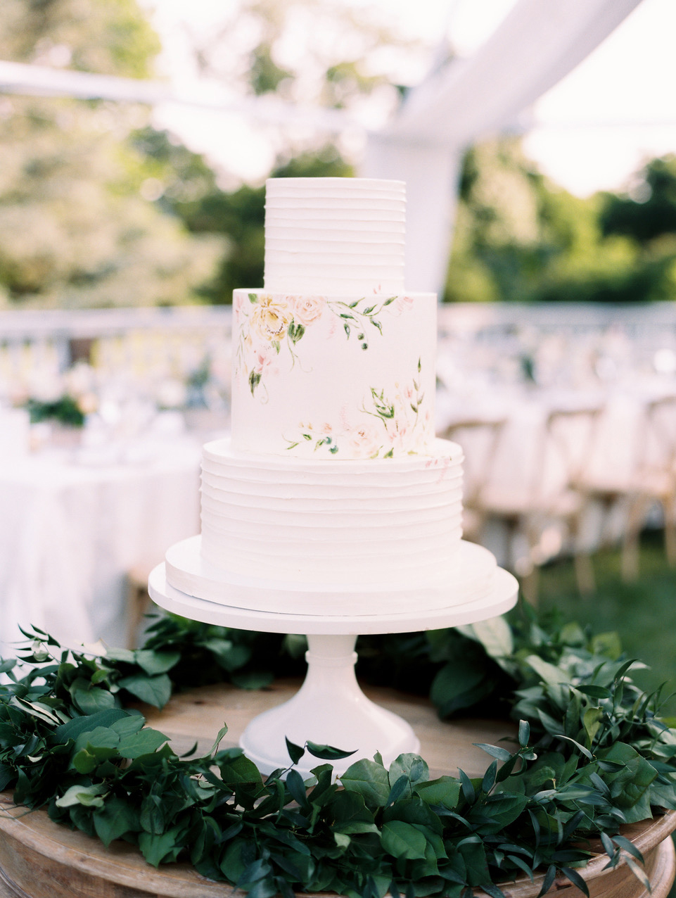 white wedding cake with patterned accent layer