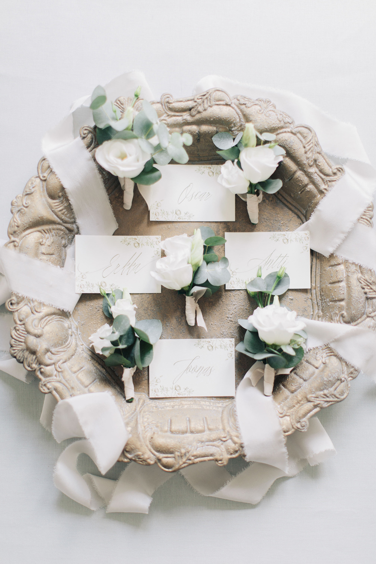 kiira arthur wedding boutonnieres on ornate tray