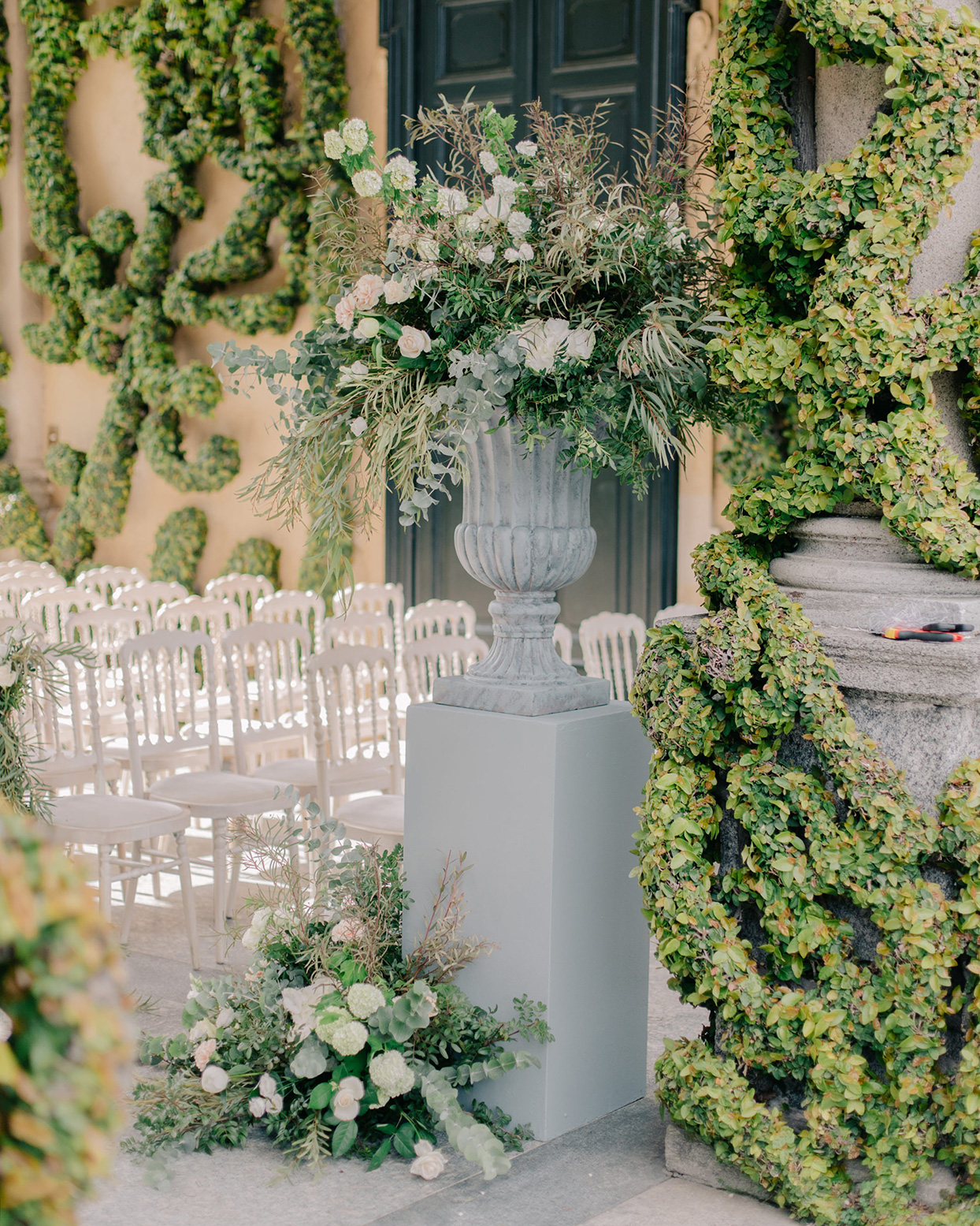 kiira arthur wedding ceremony space with large floral and greenery bouquets