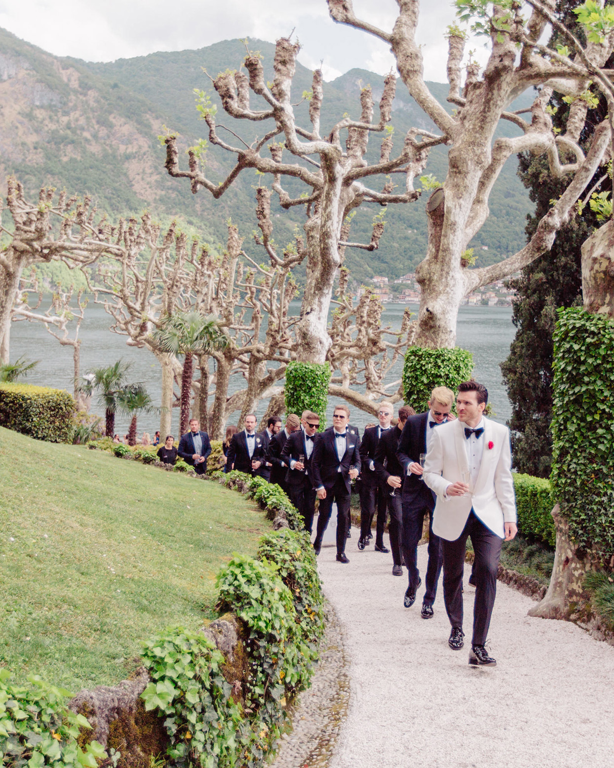 kiira arthur wedding groomsmen walking up rustic path