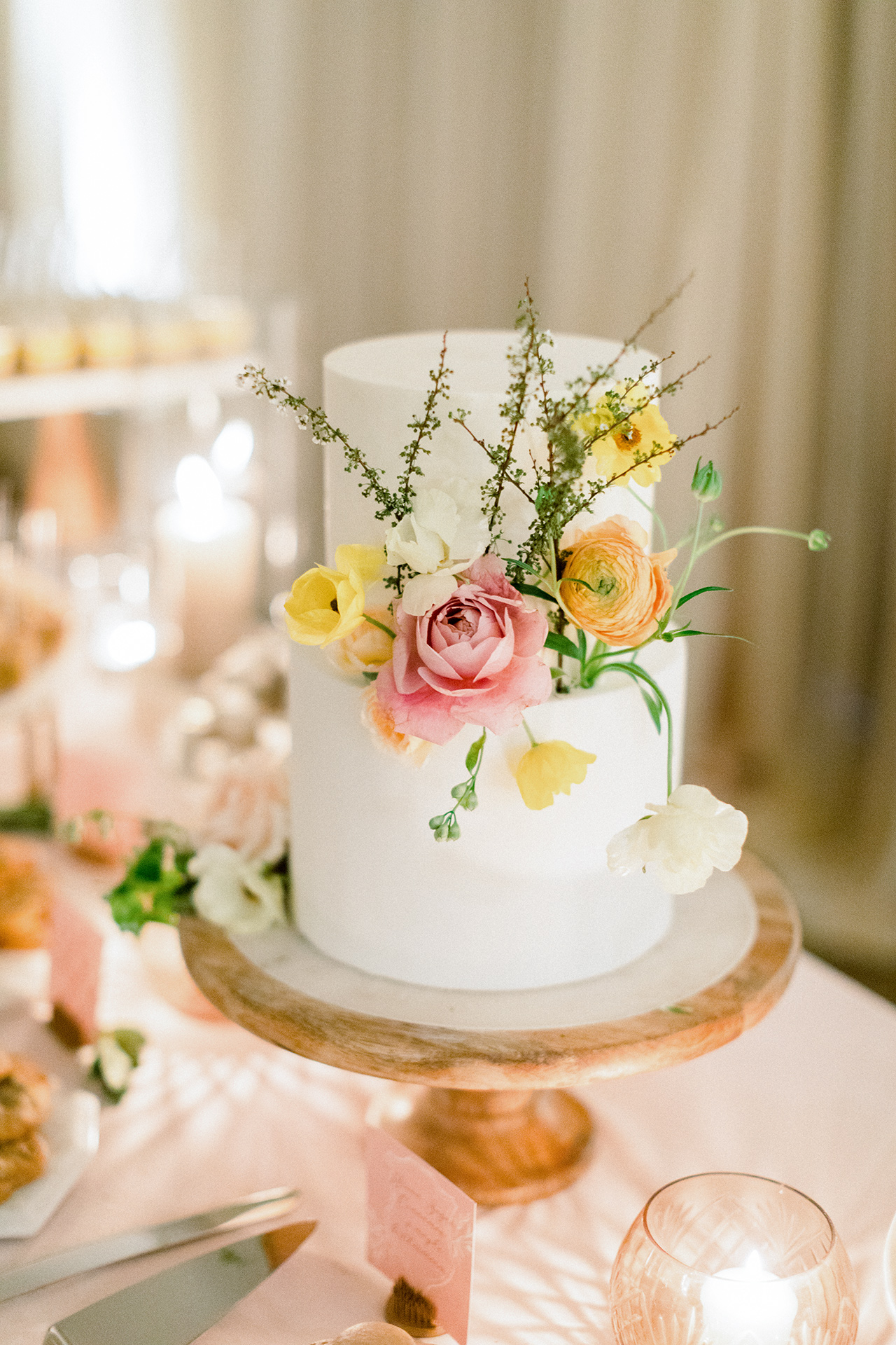 two tier couple wedding cake with flowers