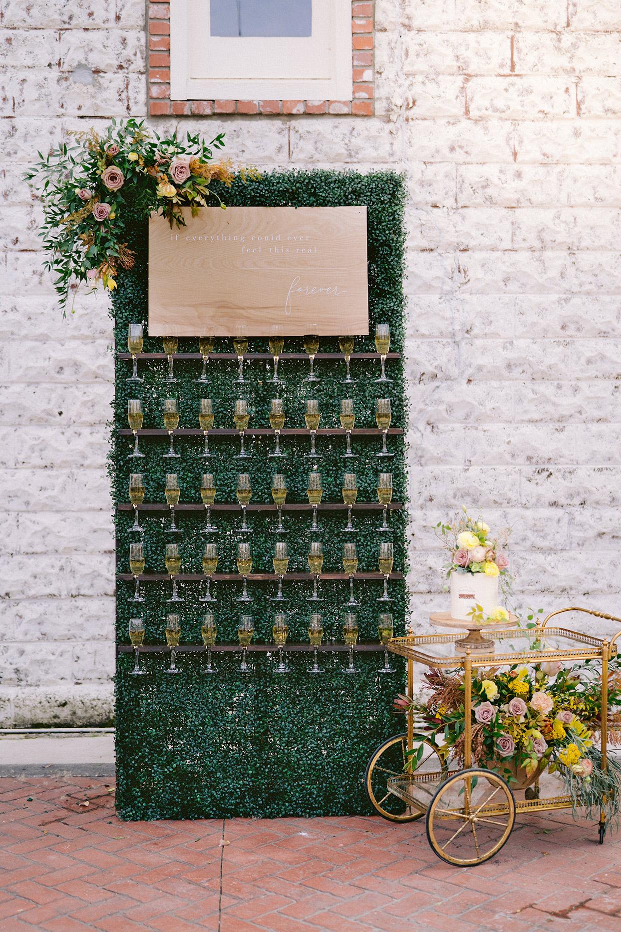 champagne wedding ideas mini wall of glasses