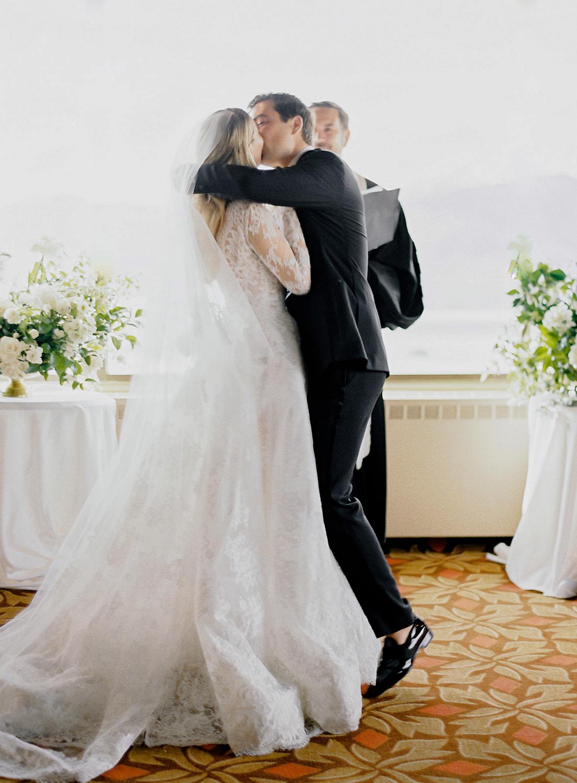 bride groom wedding reception first kiss