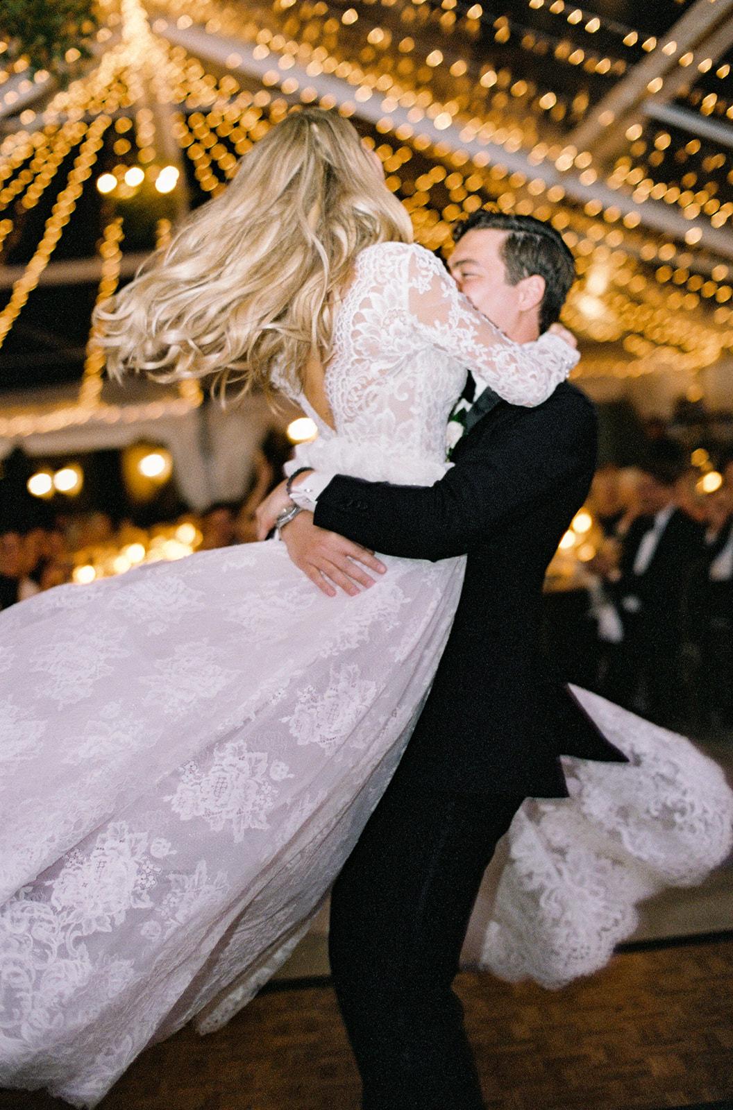 bride groom night reception dance string lights