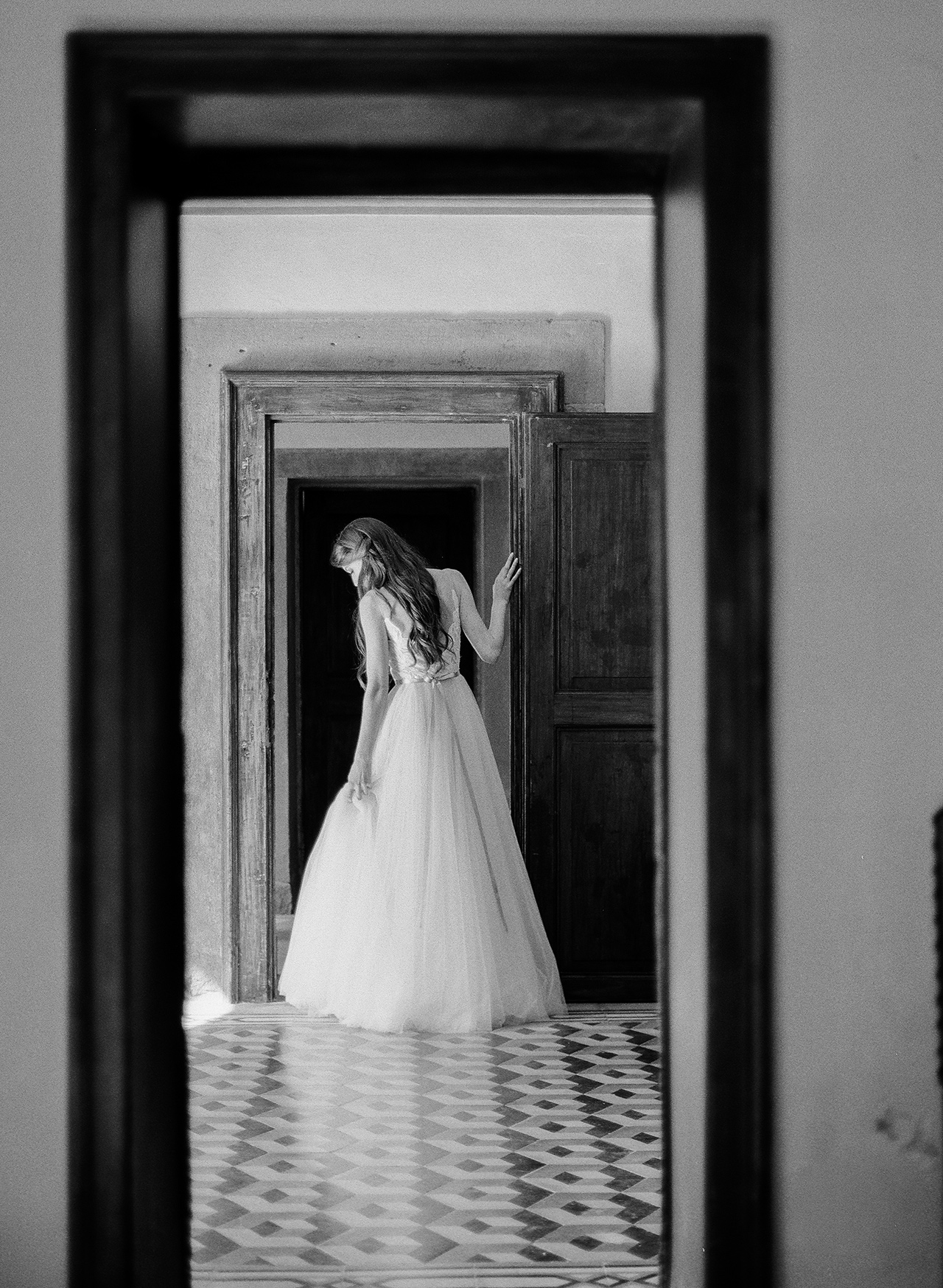 doorway view bride dress and hairstyle