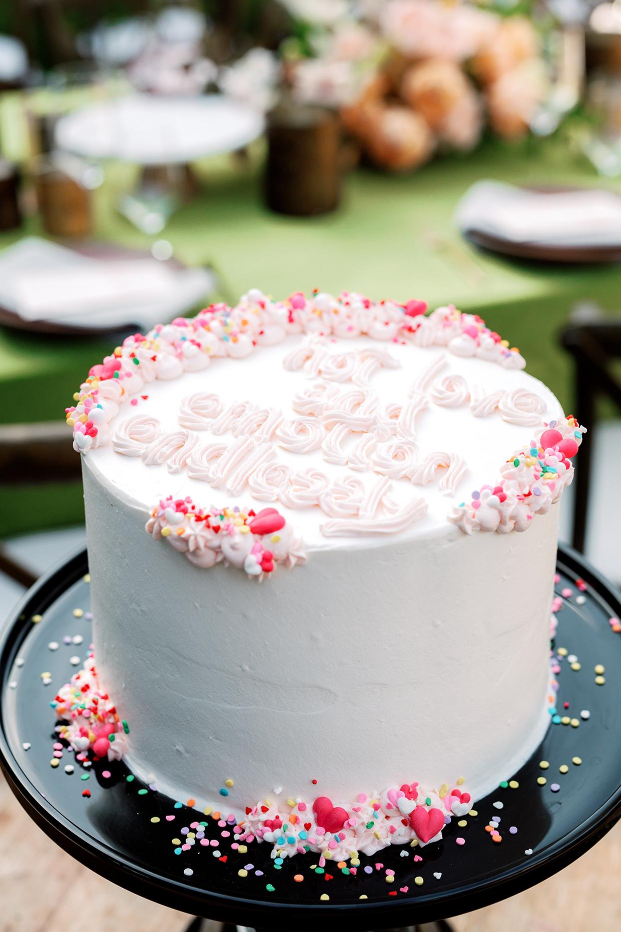 nina devon wedding cake with pink decor