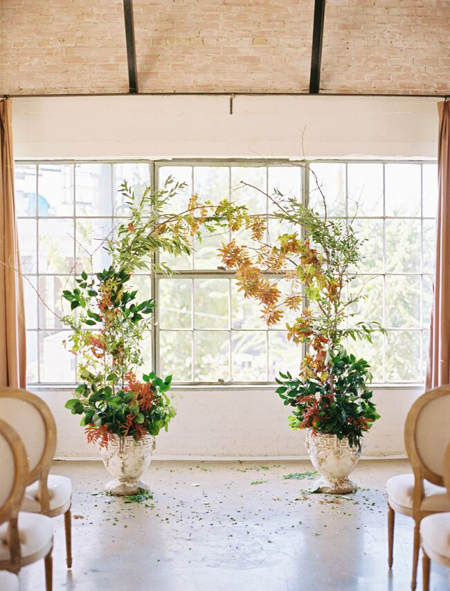 potted plants of twig branches wedding ceremony